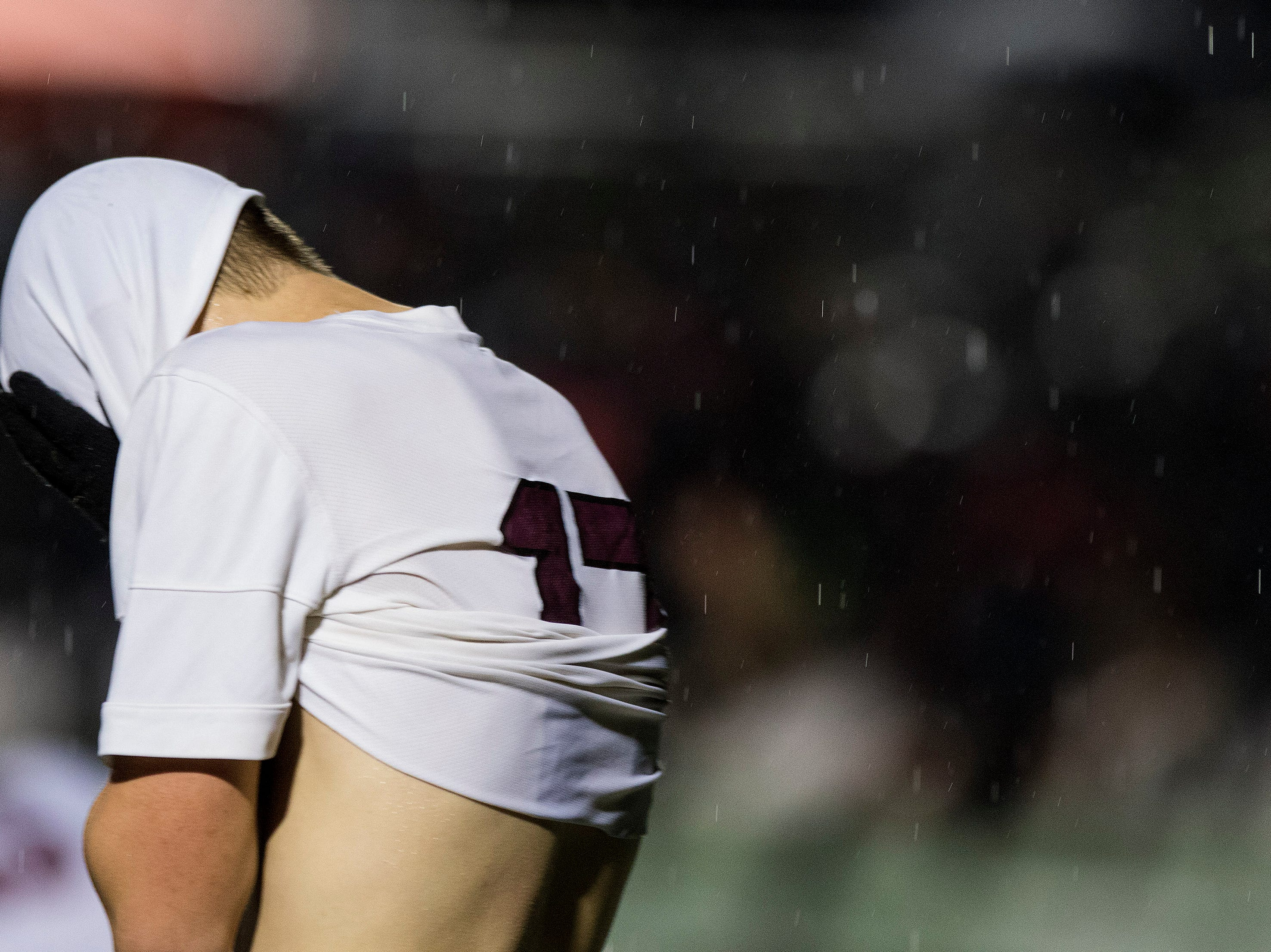 Hamilton's Derek Schlenker (17) hides his face after Trophy scored it's second goal during in the 6A State Championship game in Gilbert, Thursday, Feb 21, 2019. Brophy won 3-0.
