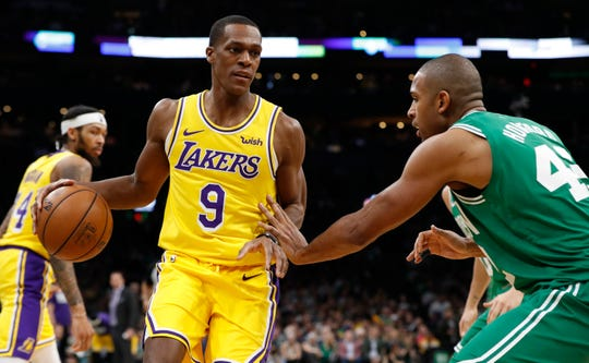 Lakers guard Rajon Rondo works with the ball against Celtics center Al Horford during a game at TD Garden.