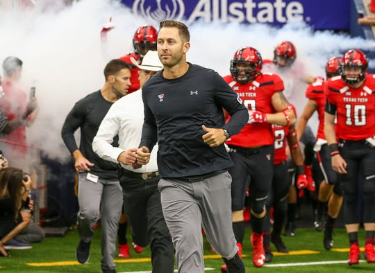 Texas Tech coach Kliff Kingsbury leads his team onto the field before a game against the Mississippi at NRG Stadium.