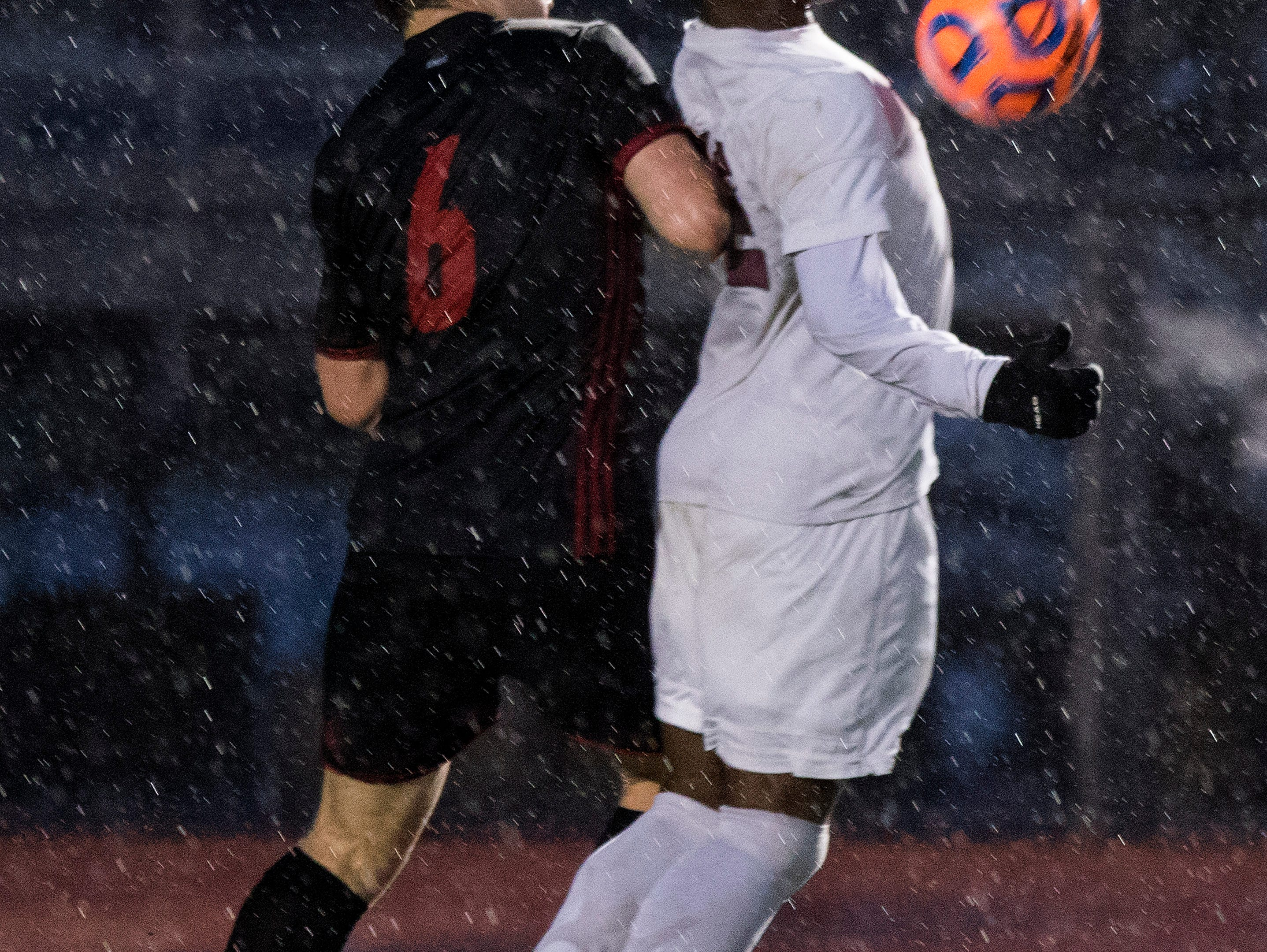 Hamilton's Channing Chasten (12) gets shoved from behind by Brophy's Juan Alvarado (6) during in the 6A State Championship game in Gilbert, Thursday, Feb 21, 2019. Brophy won 3-0.