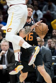 Feb 21, 2019; Cleveland, OH, USA; Phoenix Suns guard Tyler Johnson (16) is fouled by Cleveland Cavaliers forward Kevin Love (0) during the first half at Quicken Loans Arena. Mandatory Credit: Ken Blaze-USA TODAY Sports