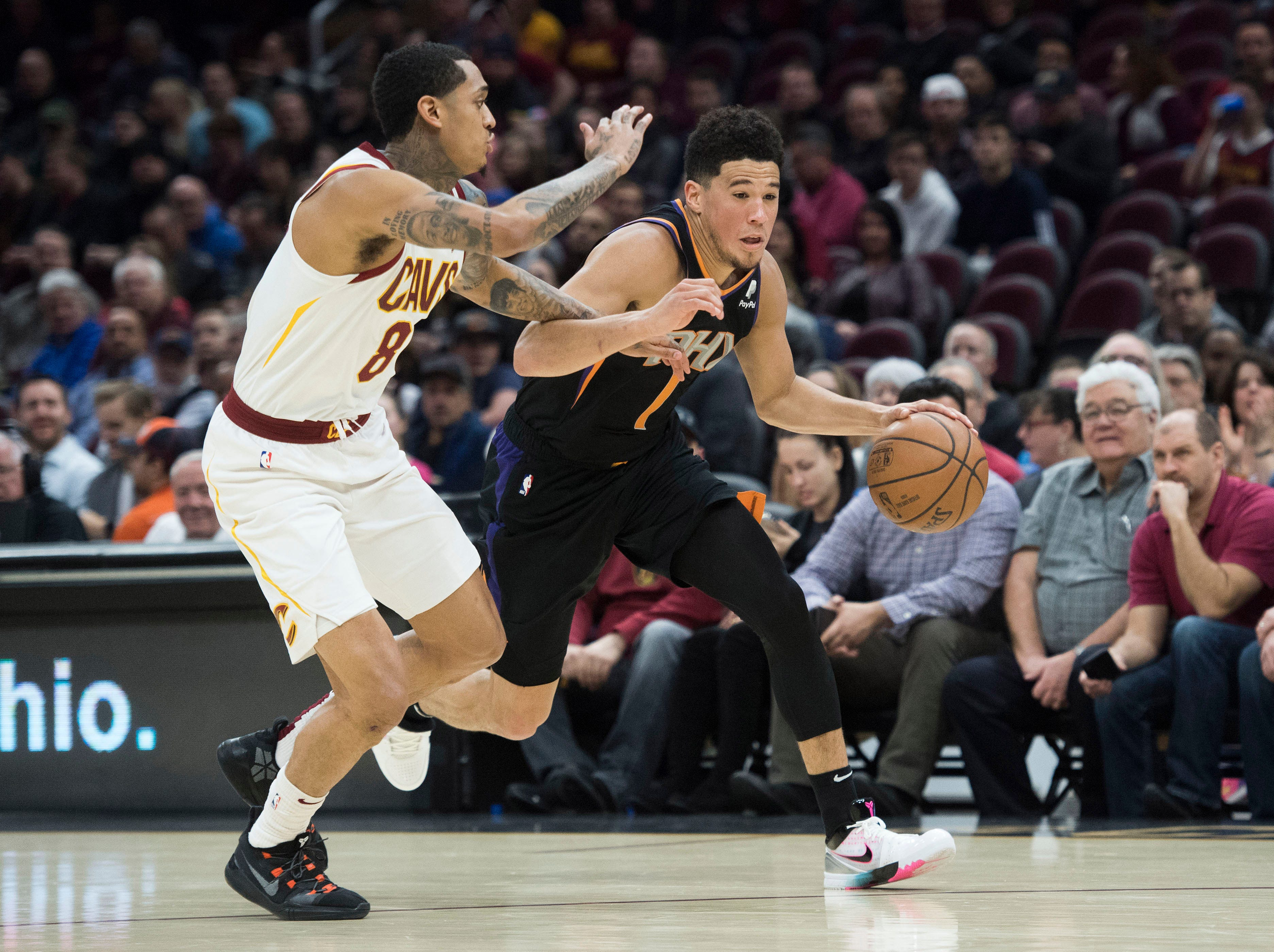 Feb 21, 2019; Cleveland, OH, USA; Phoenix Suns guard Devin Booker (1) drives to the basket against Cleveland Cavaliers guard Jordan Clarkson (8) during the first half at Quicken Loans Arena. Mandatory Credit: Ken Blaze-USA TODAY Sports