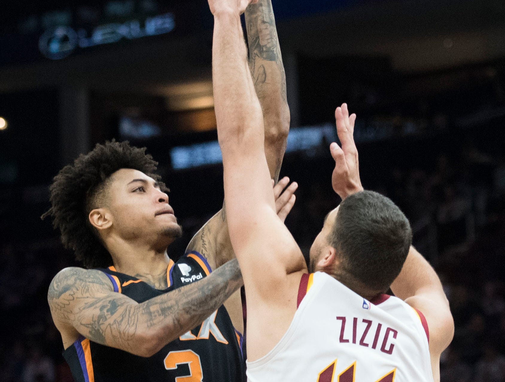 Feb 21, 2019; Cleveland, OH, USA; Phoenix Suns forward Kelly Oubre Jr. (3) shoots over Cleveland Cavaliers center Ante Zizic (41) during the first half at Quicken Loans Arena. Mandatory Credit: Ken Blaze-USA TODAY Sports