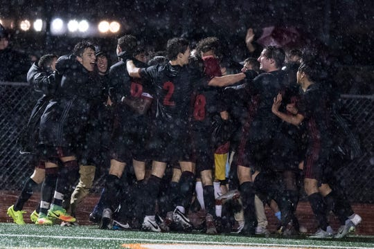 Brophy players celebrate their second goal over Hamilton in the 6A State Championship game in Gilbert, Thursday, Feb 21, 2019. Brophy won 3-0.