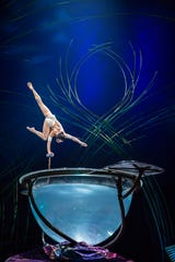 """A giant waterbowl lets acrobats show off a variety of skills in Cirque du Soleil's big-top show """"Amaluna."""""""