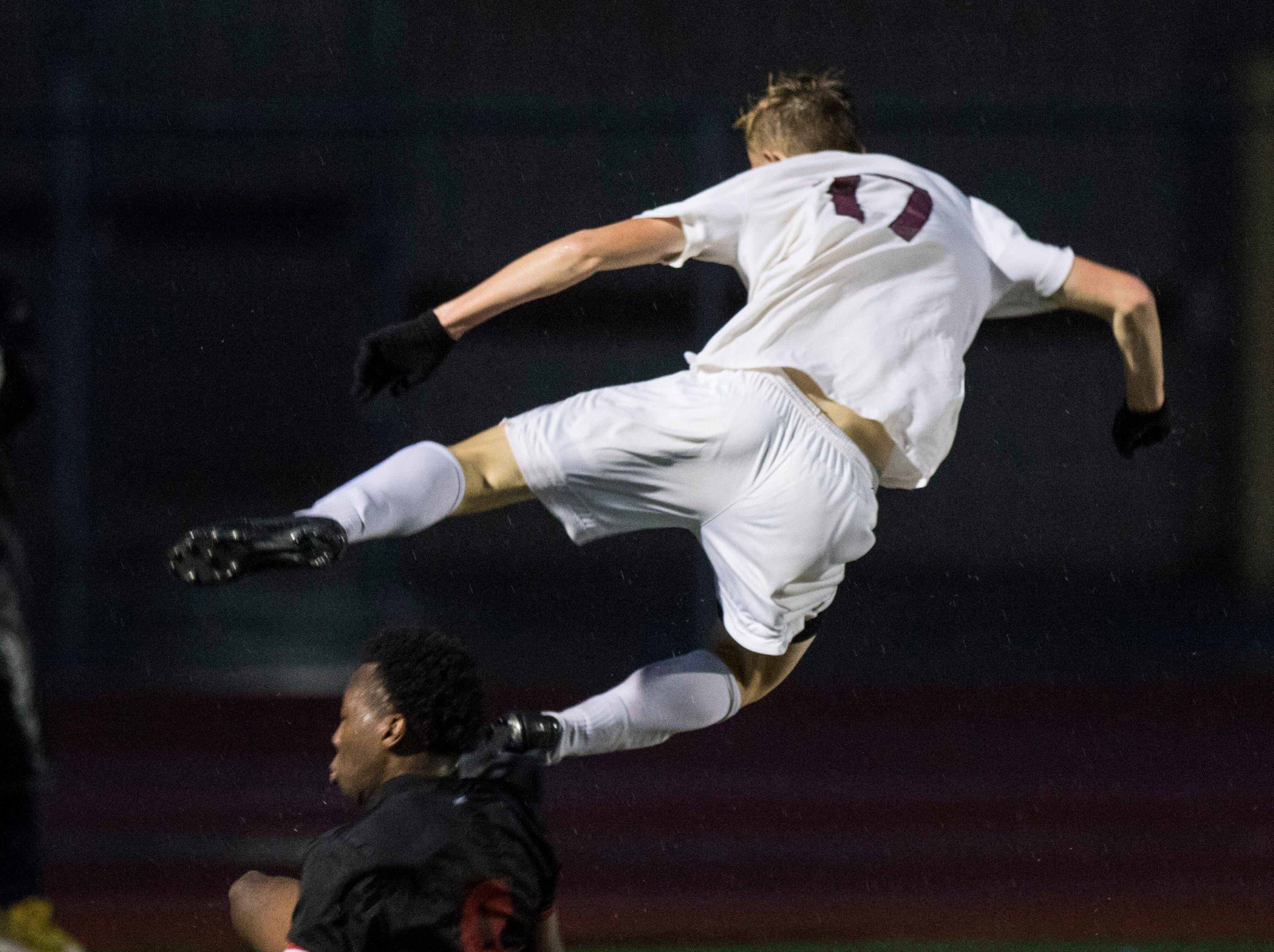 Hamilton's Derek Schlenker (17) goes flying after getting tackled by Brophy's Deric HallÊ(9) during in the 6A State Championship game in Gilbert, Thursday, Feb 21, 2019. Brophy won 3-0.