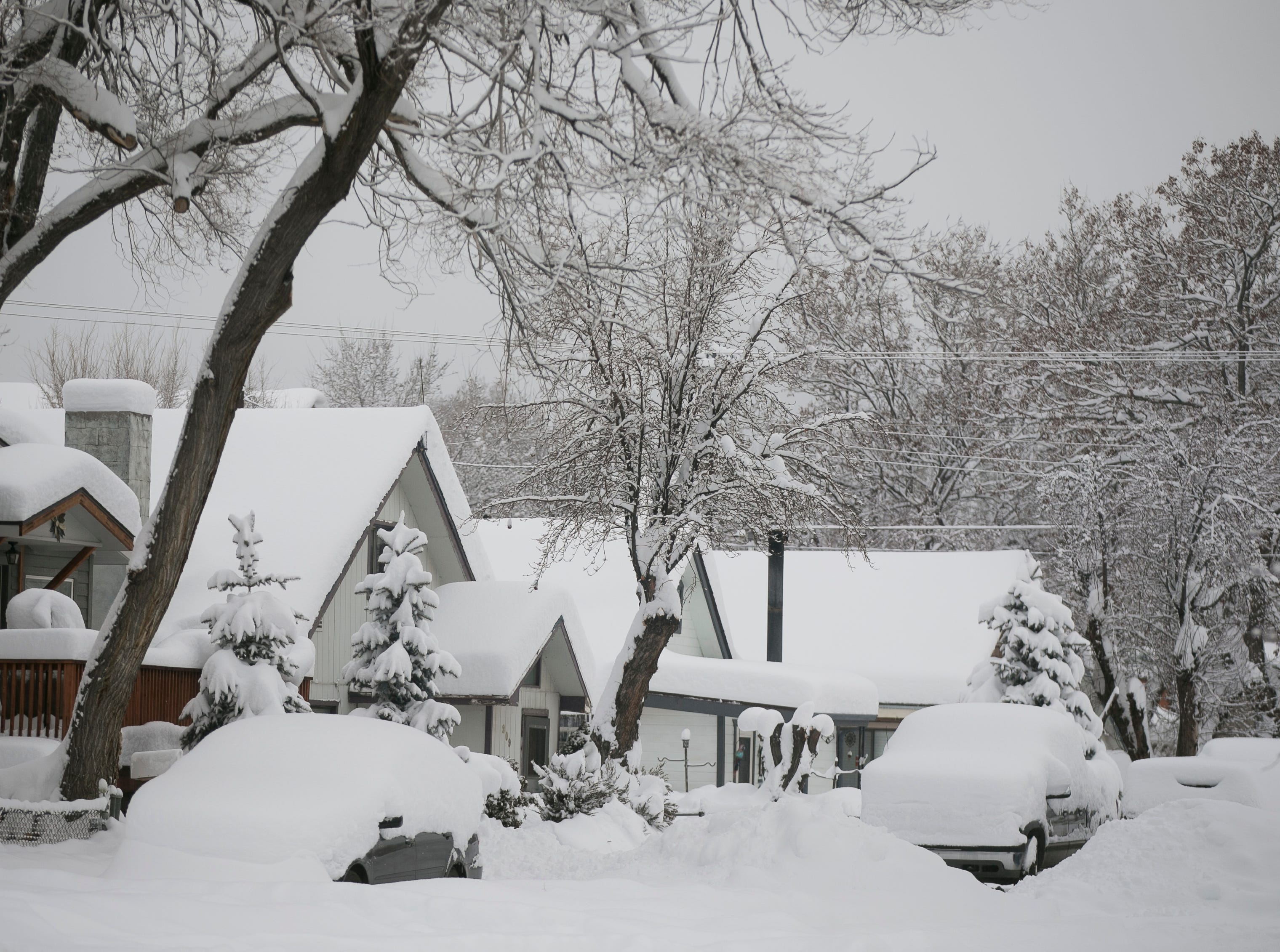 Snow blankets homes and cars the morning after a snow storm in Flagstaff on Feb. 22, 2019. The day before, a snow storm set the record for the most amount of snowfall in a day in Flagstaff