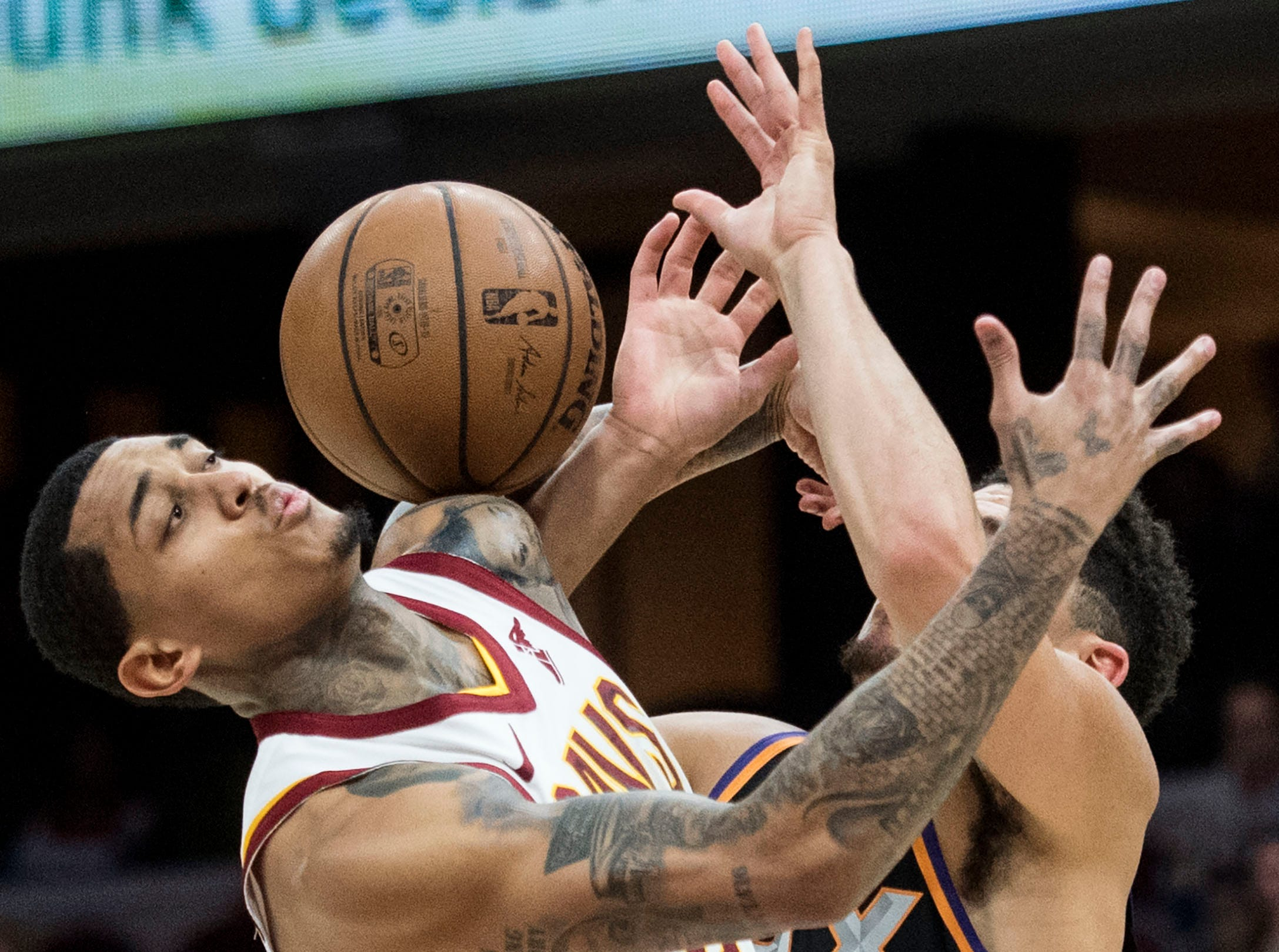 Feb 21, 2019; Cleveland, OH, USA; Cleveland Cavaliers guard Jordan Clarkson (8) and Phoenix Suns guard Devin Booker (1) battle for a loose ball during the first half at Quicken Loans Arena. Mandatory Credit: Ken Blaze-USA TODAY Sports