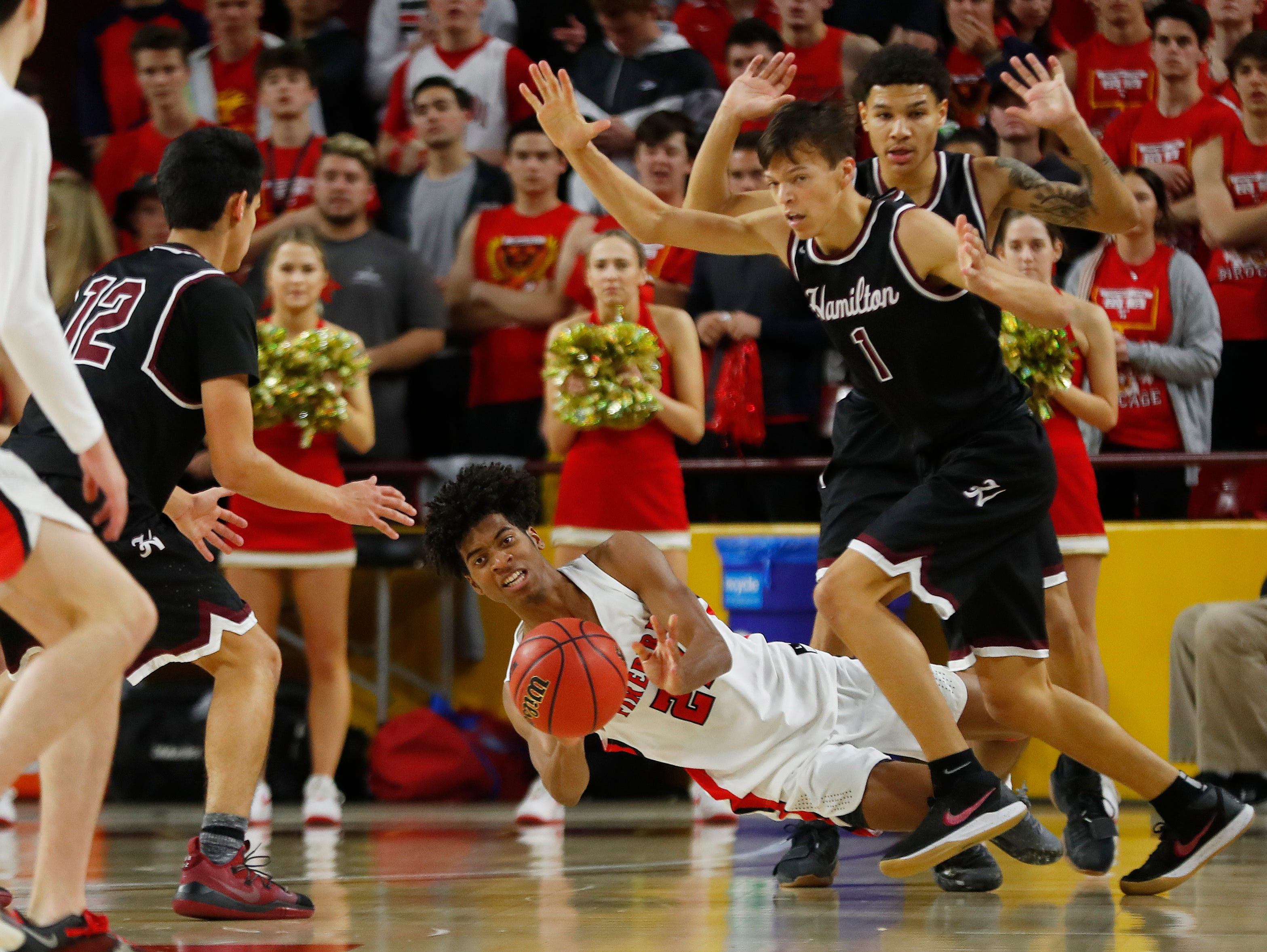 Chaparral's Jordan Josephs (24) passes as he fouls from a foul on Hamilton's Jamar Brown (1) during second half of the 6A boys basketball semifinal game at Wells Fargo Arena in Tempe, Ariz. on February 21, 2019.