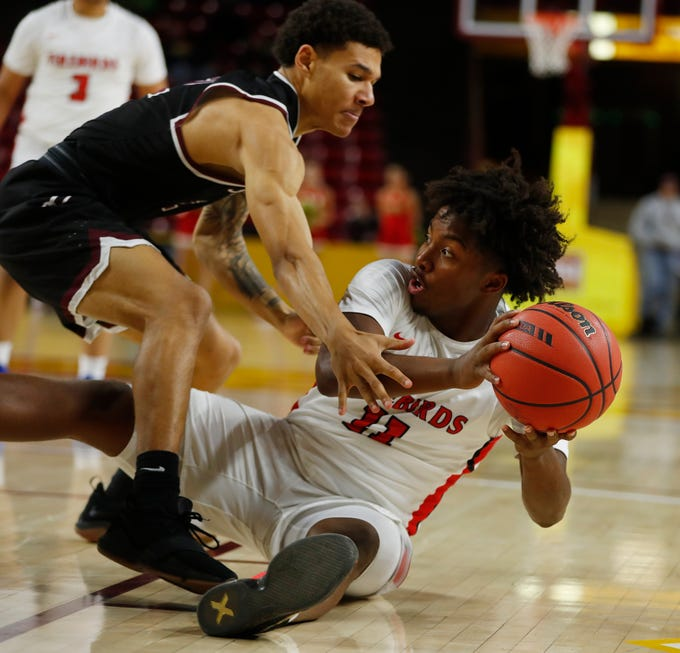 Chaparral's Micah Burno (11) passes after recovering a loose ball against Hamilton's Malik Whitaker (2) during first half of the 6A boys basketball semifinal game at Wells Fargo Arena in Tempe, Ariz. on February 21, 2019.