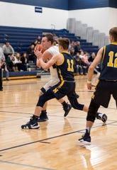 Port Huron Northern guard James DeLong (11) defends against Marysville guard Cade Perrin during their basketball game Thursday, Feb. 21, 2019 at Marysville High School.