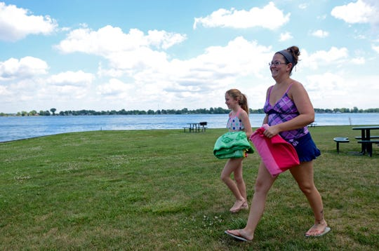 Pam Stanley, of Roseville, walks to the beach with her daughter, Mackenzie Spears, then age 11, in July 2016 in Marine City. At the time a restroom and pavilion were slated to be installed south of the beach, whereas parking discussions had been postponed earlier that year.