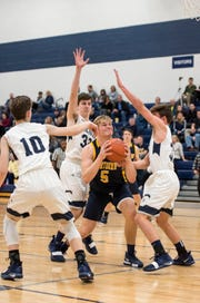 Players from Marysville attempt to block Port Huron Northern's Braiden McGregor (5) during their basketball game Thursday, Feb. 21, 2019 at Marysville High School.