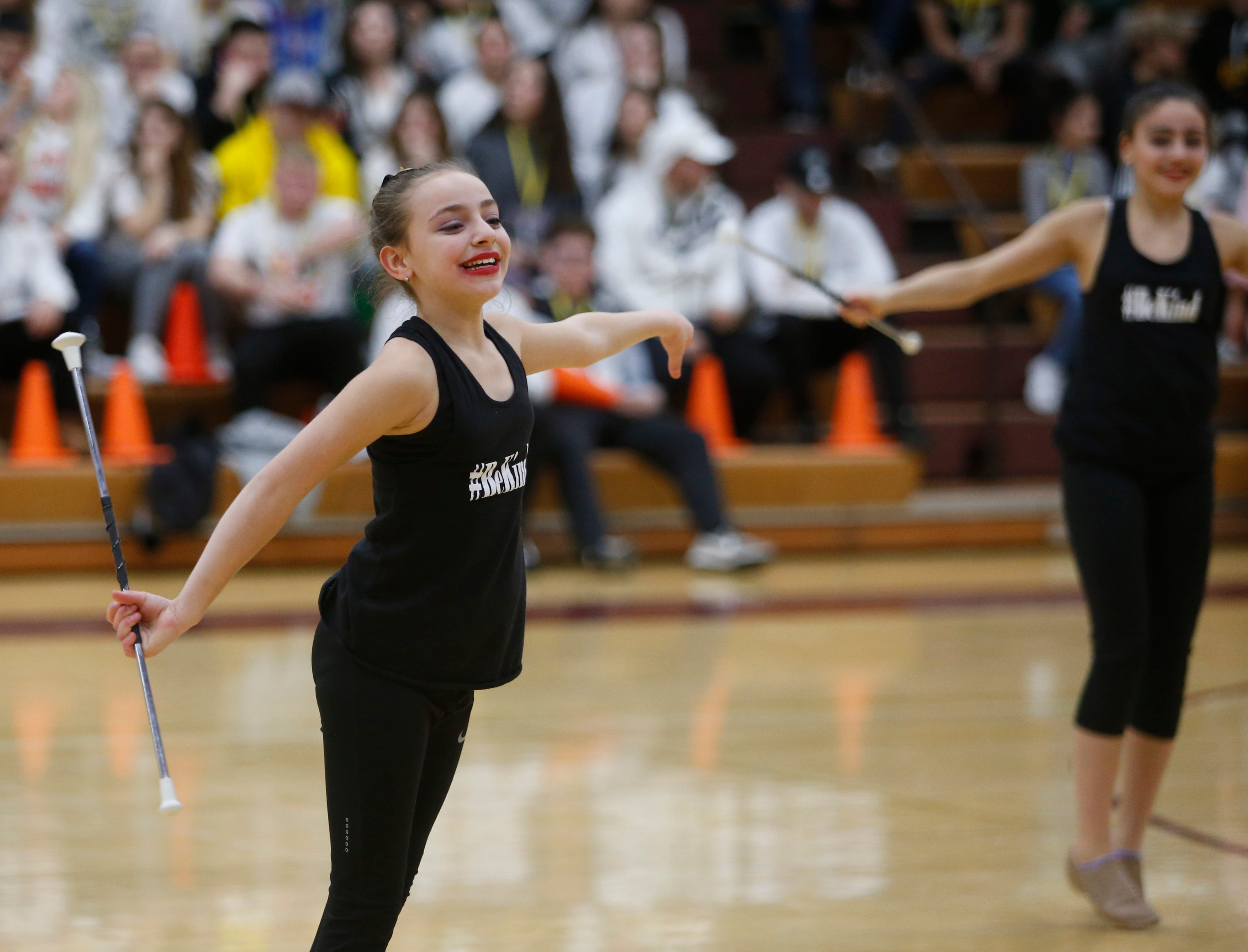Baton twirling during halftime at Thursday's playoff game between Arlington and New Rochelle in Freedom Plains on February 21, 2019.