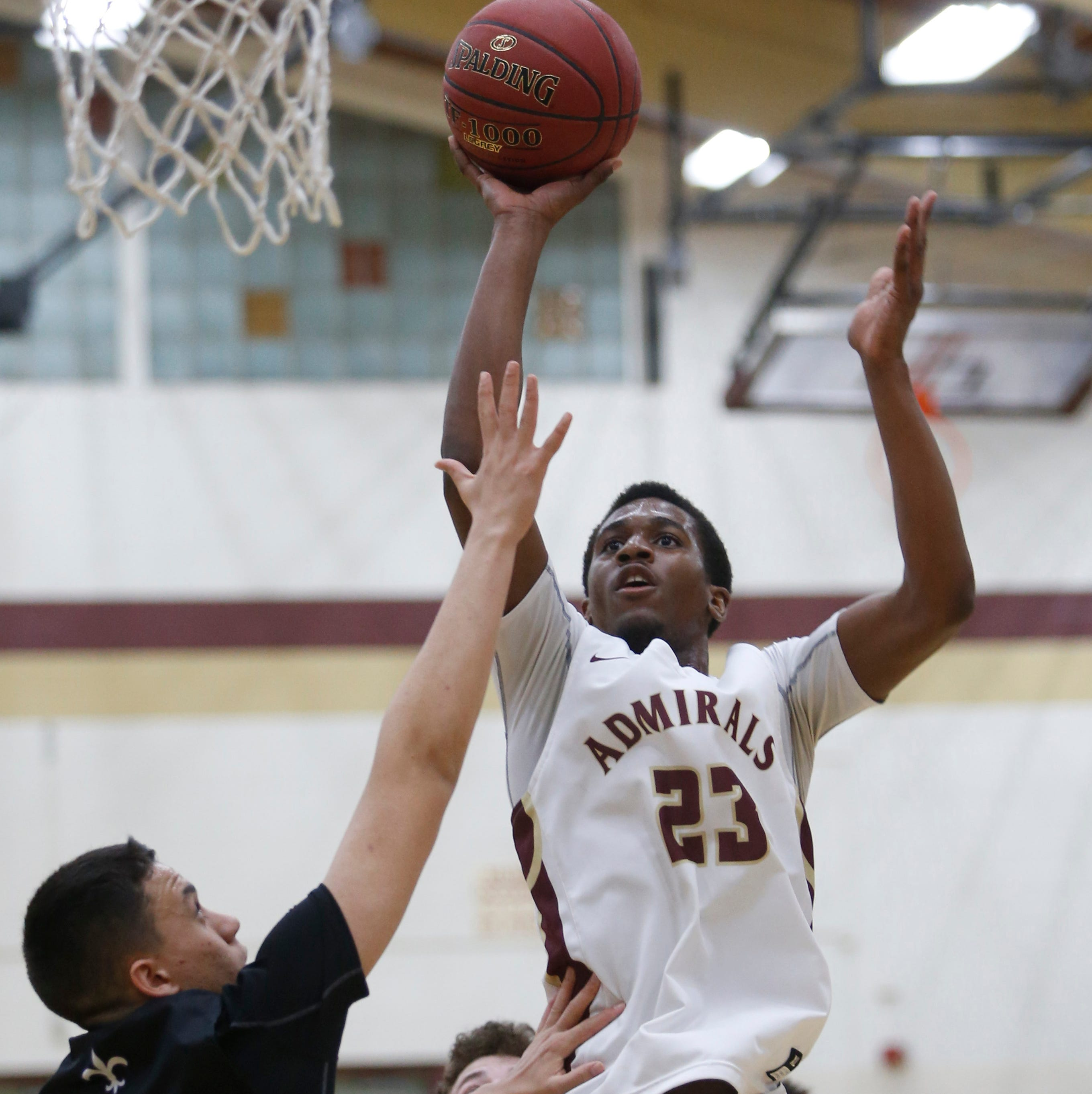 Arlington's Rashawn Grant takes a jump shot as New Rochelle's Prakash Ketterhagan tries to block him during Thursday's game in Freedom Plains on February 21, 2019.