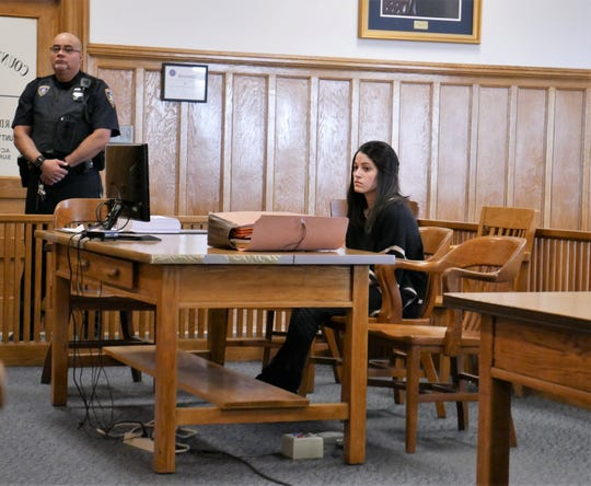 Nicole Addimando sits at the defense table in Dutchess County Court on Feb. 22, 2019, while her attorneys speak with the judge and prosecutors. Addimando is charged with second-degree murder and other felonies in the death of her longtime boyfriend, Christopher Grover.