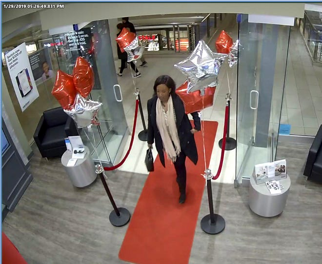 The woman accused of purchasing more than $2,500 in Apple products using another woman's personal information at the Poughkeepsie Galleria Mall captured in a surveillance photo.