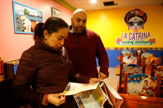 Co-owners of La Catrina Restaurant, Karina & Ron Bantine, review a draft of the restaurant's menu on February 20, 2019. The family friendly Mexican restaurant will open in Spring of 2019.