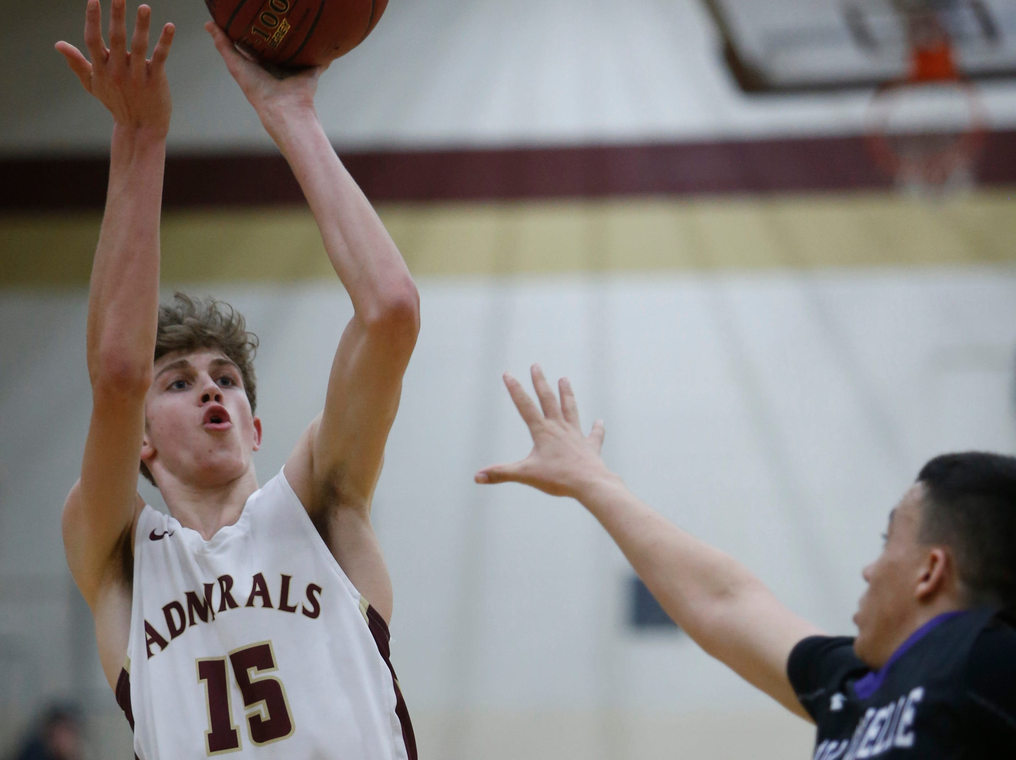 Arlington's Jake Weinstein takes a jump shot as New Rochelle's Prakash Ketterhagan tries to block him during Thursday's game in Freedom Plains on February 21, 2019.