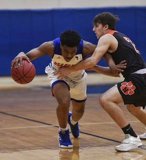 Clovis Gallon Jr. of York High drives past Northeastern's Andrew Brodbeck in a game earlier this season. Gallon Jr. was named the Y-A League Division I Player of the Year by the league's coaches last week. John A. Pavoncello photo