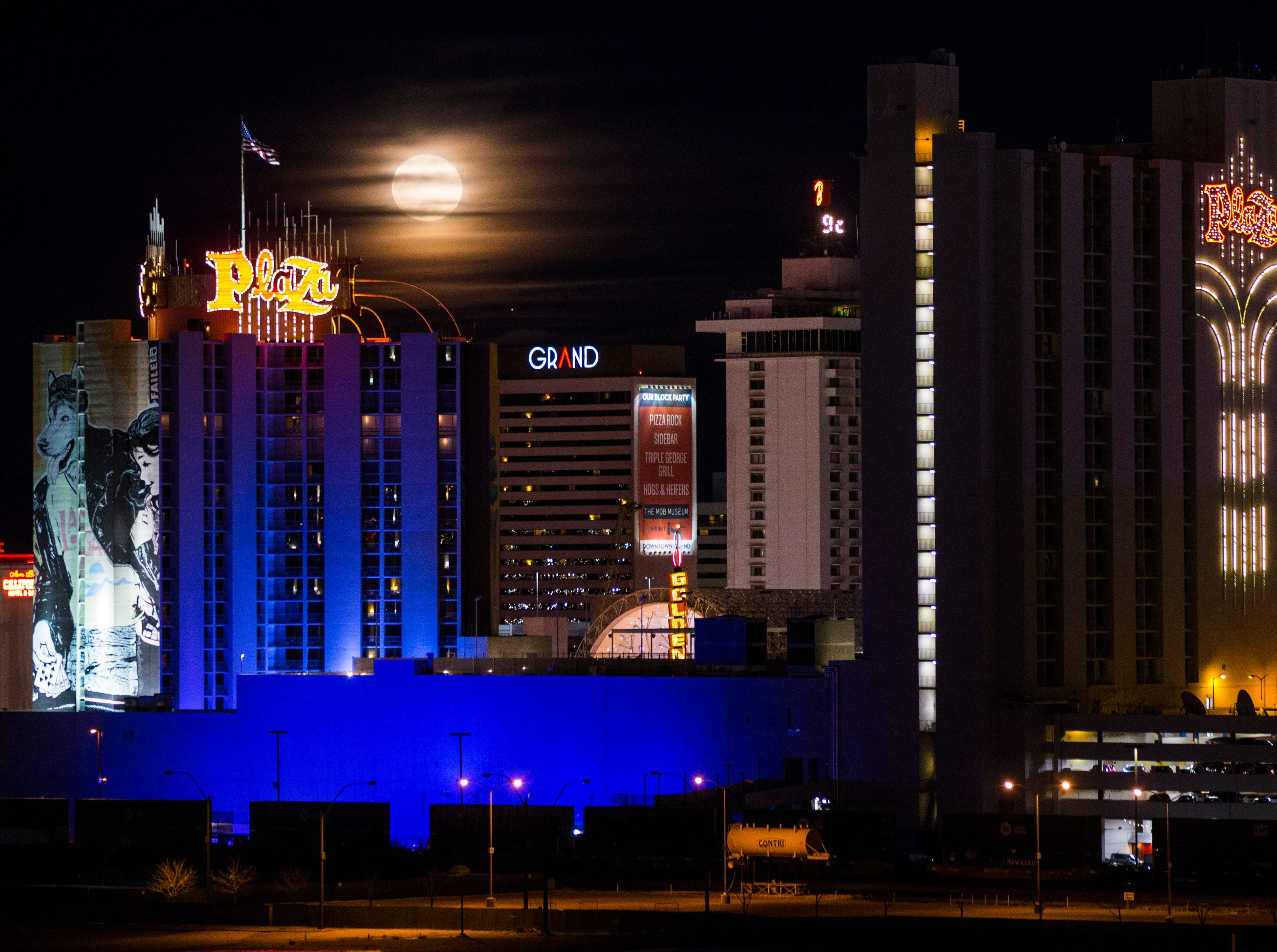 A super snow moon rises over the Plaza Hotel and Casino in downtown Las Vegas on Tuesday, Feb. 19, 2019. (Chase Stevens/Las Vegas Review-Journal via AP)