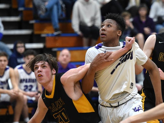 Galena Trae Thomson and Spanish Springs' Cordell Stinson look to get the rebound during the Northern Region Championship playoff game at Carson High School on Feb. 21, 2019. Spanish Springs beat 51-44.