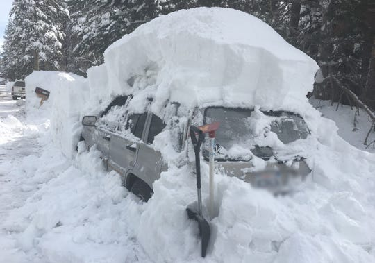 Even after some digging, this car with California tags still isn't free from snow.