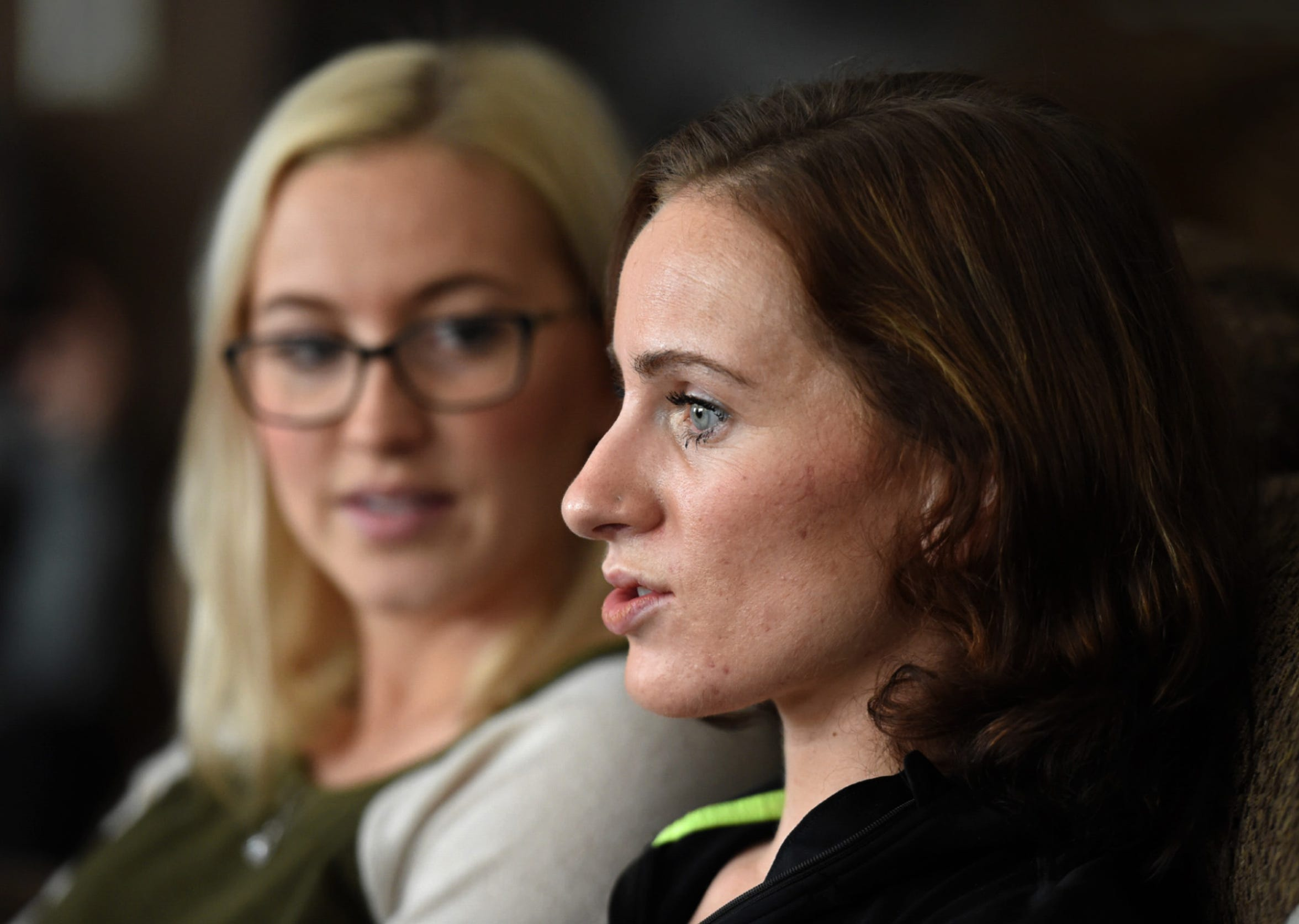 Kelly Cass, right, talks about the accident, her recovery and outlook as she sits next to her sister Kayla Dowty at their mother's Reno home on Feb. 18, 2019. Cass is recovering after being hit by a suspected drunk driver as she rode her skateboard near her Citrus Heights, Calif., apartment in December.