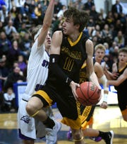 Galena's Cameron Lewis shoots with Spanish Springs' Brock O'Connell covering him during the Northern Region Championship playoff game at Carson High School on Feb. 21, 2019. Spanish Springs beat Galena 51-44.
