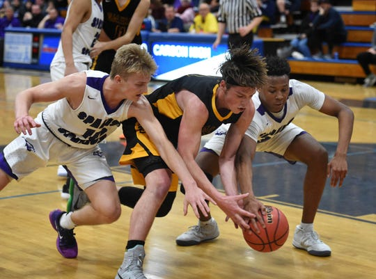 Spanish Springs' Nate Miller and Cordell Stinson battle for a losse ball aginst Galena's Trae Thomson, center,  late in the Northern Region Championship playoff game at Carson High School on Feb. 21, 2019. Spanish Springs beat Galena 51-44.
