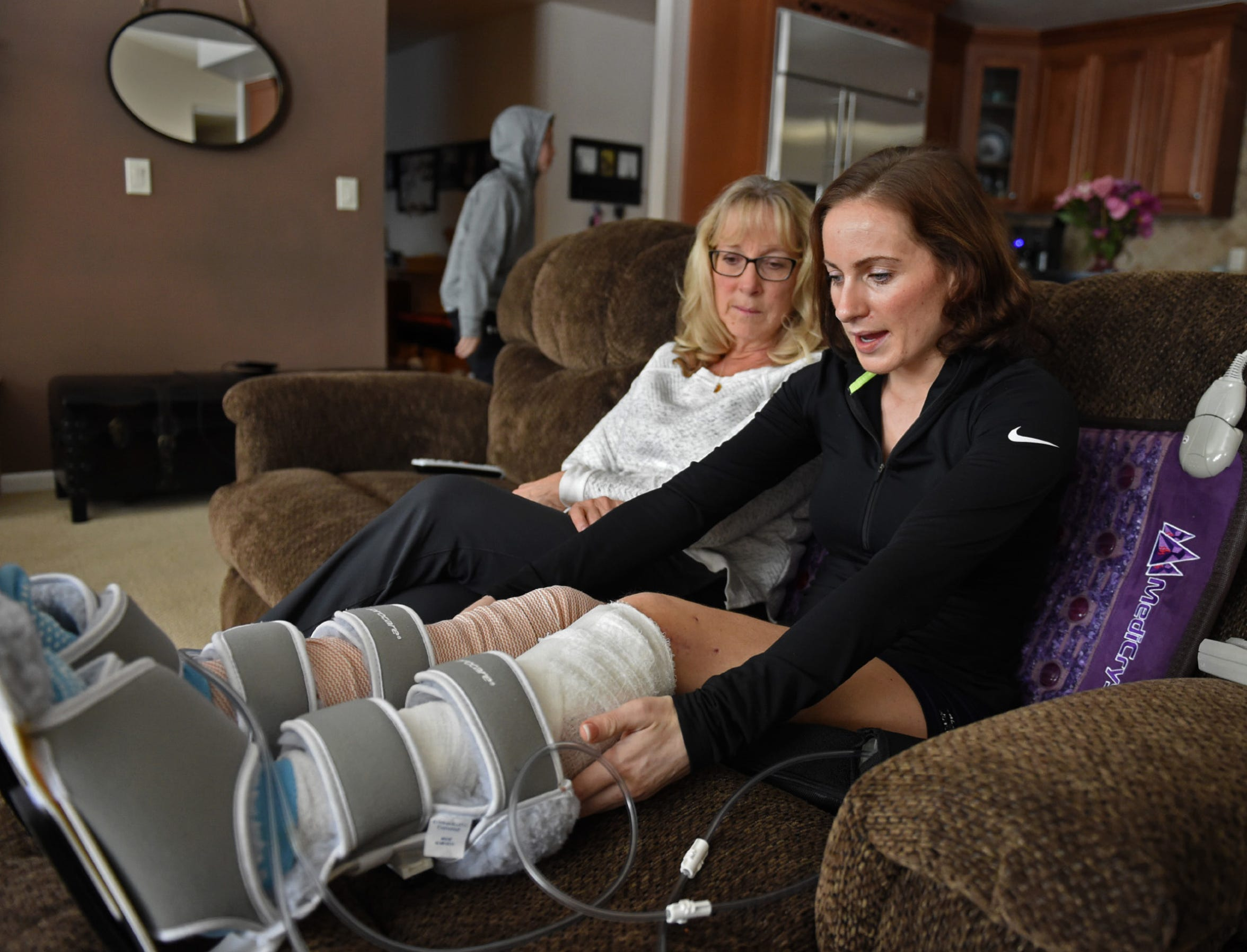 Kelly Cass, right, talks about the accident, her recovery and outlook as she sits next to her mother Cristie in ther mother's Reno home on Feb. 18, 2019. Cass is recovering after being hit by a drunk driver as she rode her skateboard near her Sacramento apartment in December.