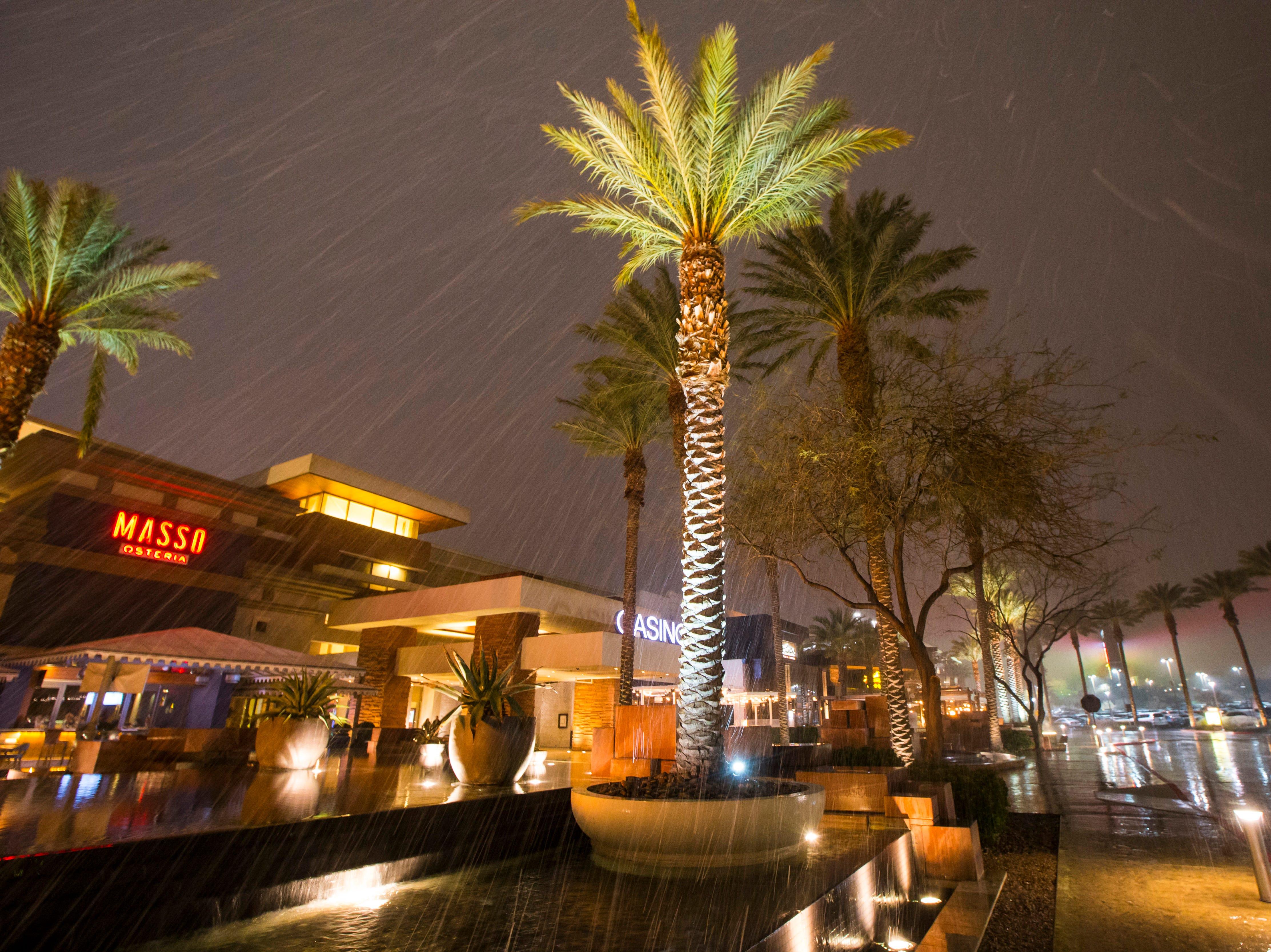 Snow falls outside of Red Rock Resort in Las Vegas on Wednesday, Feb. 20, 2019. (Chase Stevens/Las Vegas Review-Journal via AP)