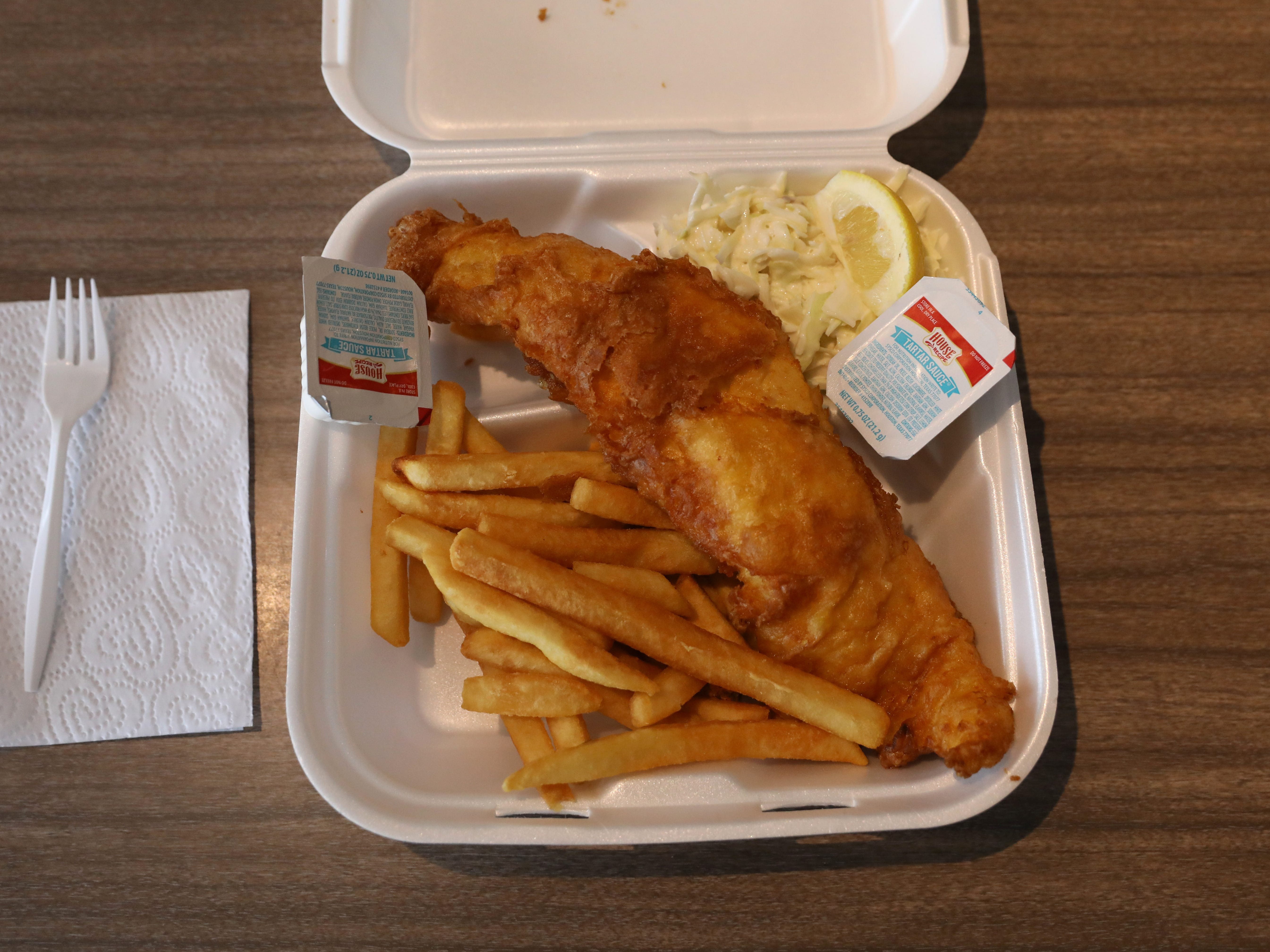 The fish fry at Captain Jim's Fish Market is packaged for takeout.
