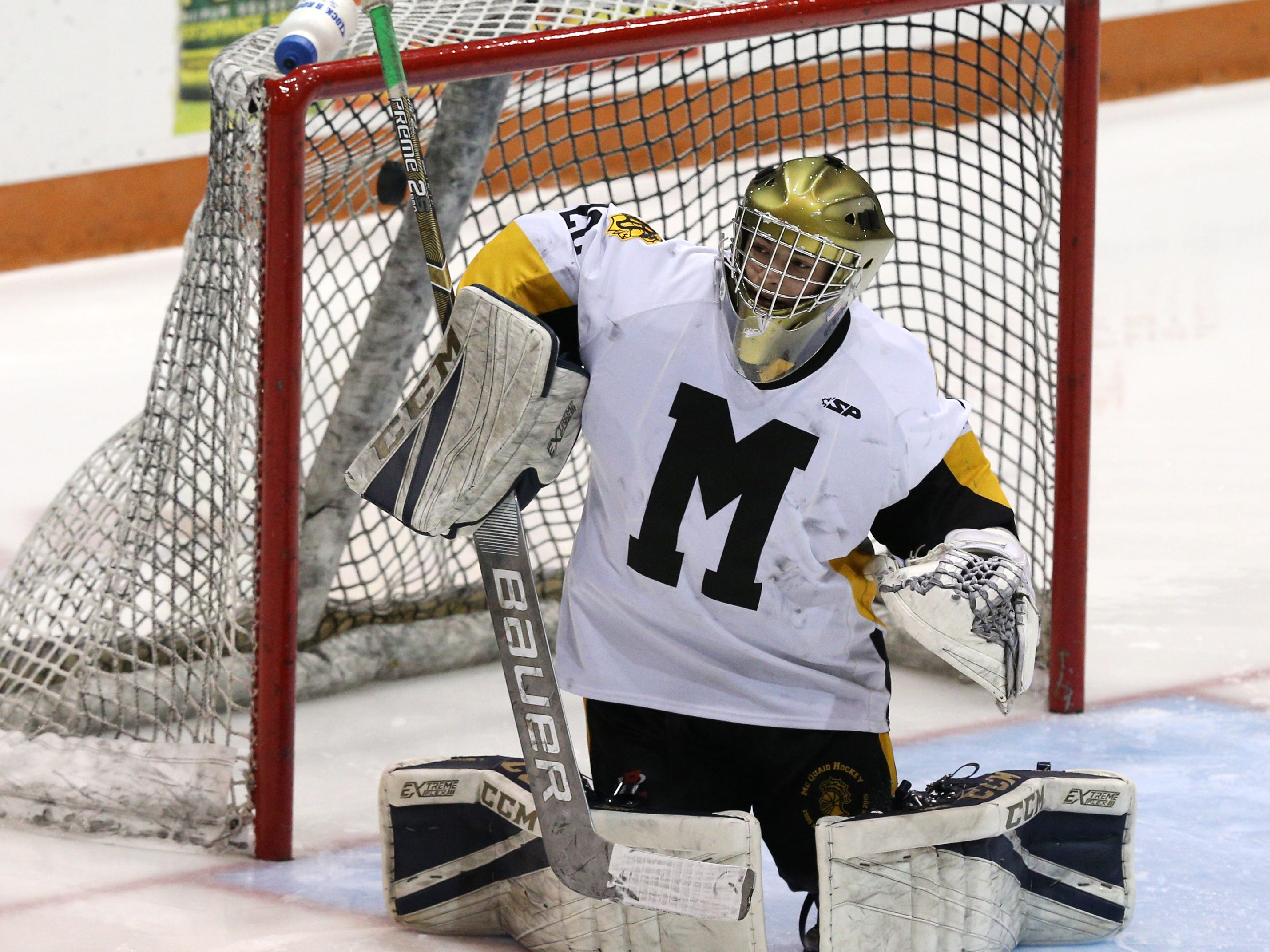 McQuaid's David Battisti can't prevent this shot from Pittsford's Danny Judge from entering the net.