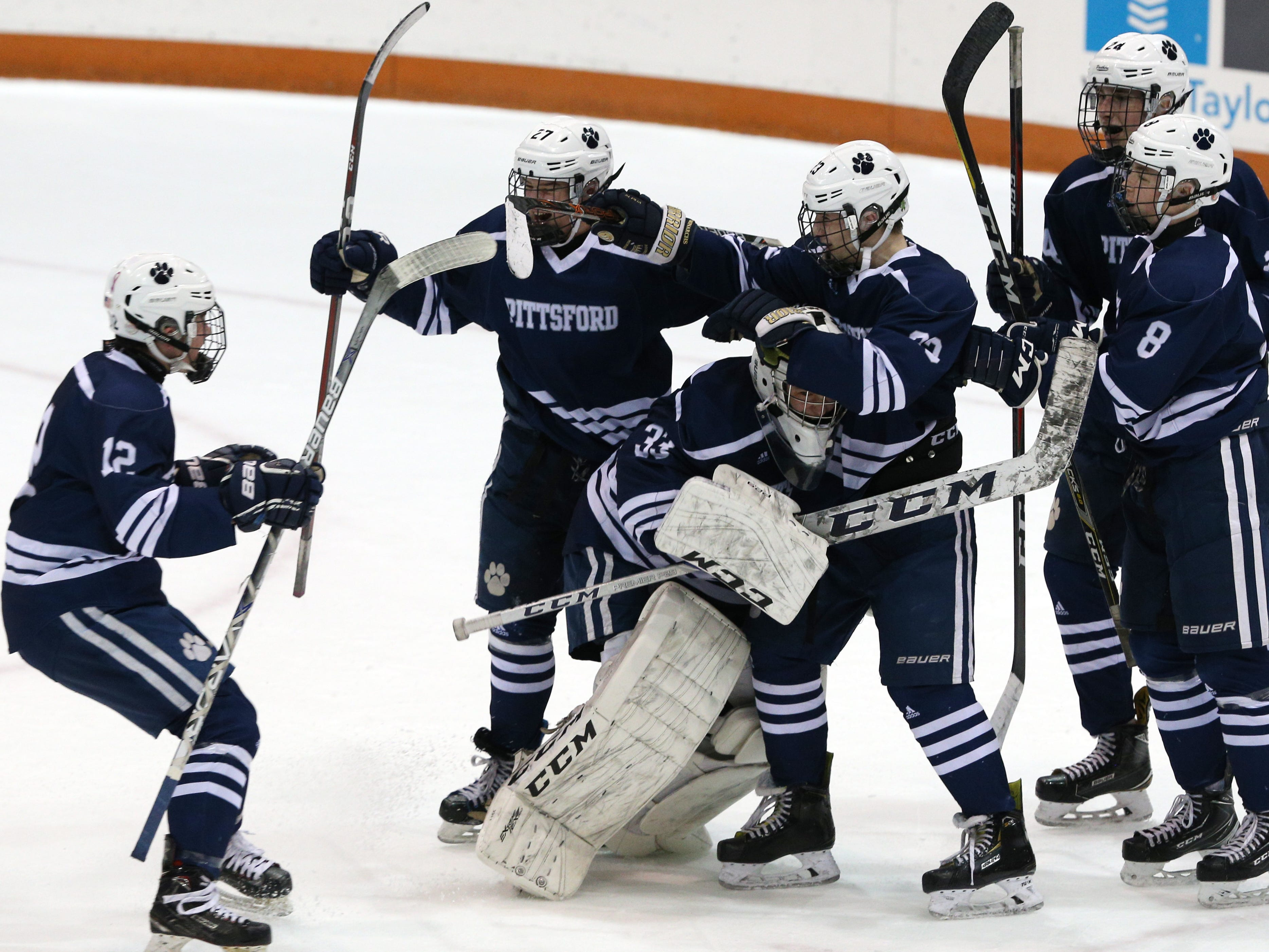 Pittsford celebrates its 4-2 victory over McQuaid on Thursday.