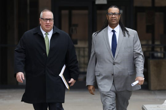 City Council Vice President Adam (right) leaves court with his lawyer,  Joseph S. Damelio. McFadden was arrested on charges related to financial activities at a charitable arm of the Rochester Housing Authority.