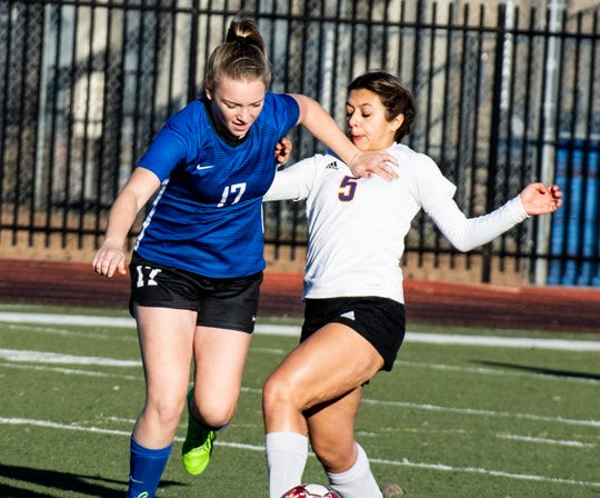 U-Prep senior Emma Nichols tries to win the ball from Live Oak's Baylee Alvarado during the Panthers' 6-0 win in a Division II Northern Section semifinal on Thursday, Feb. 21, 2019.