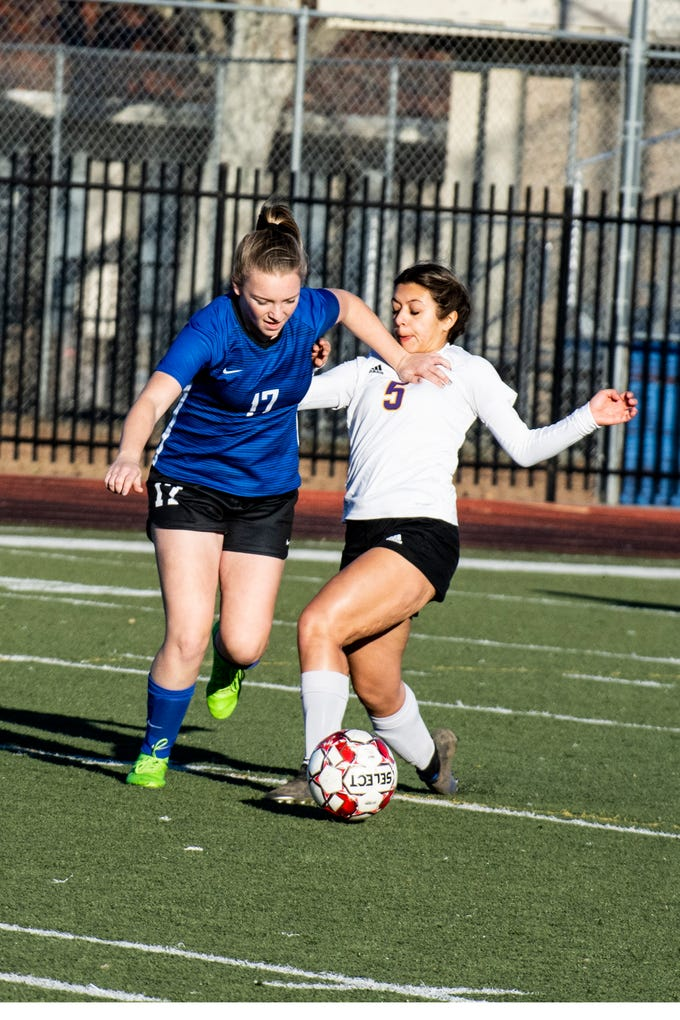 U-Prep junior Emma Nichols tries to win the ball from Live Oak's Baylee Alvarado during the Panthers' 6-0 win in a Division II Northern Section semifinal on Thursday, Feb. 21.