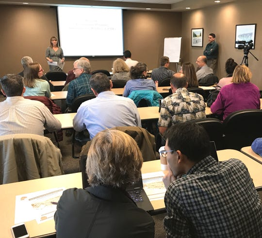 Assistant City Manager Sheri DeMaagd, top left, opens the Community Planning Assistance for Wildfire stakeholder kick-off meeting Thursday at Redding City Hall where about 45 people attended.