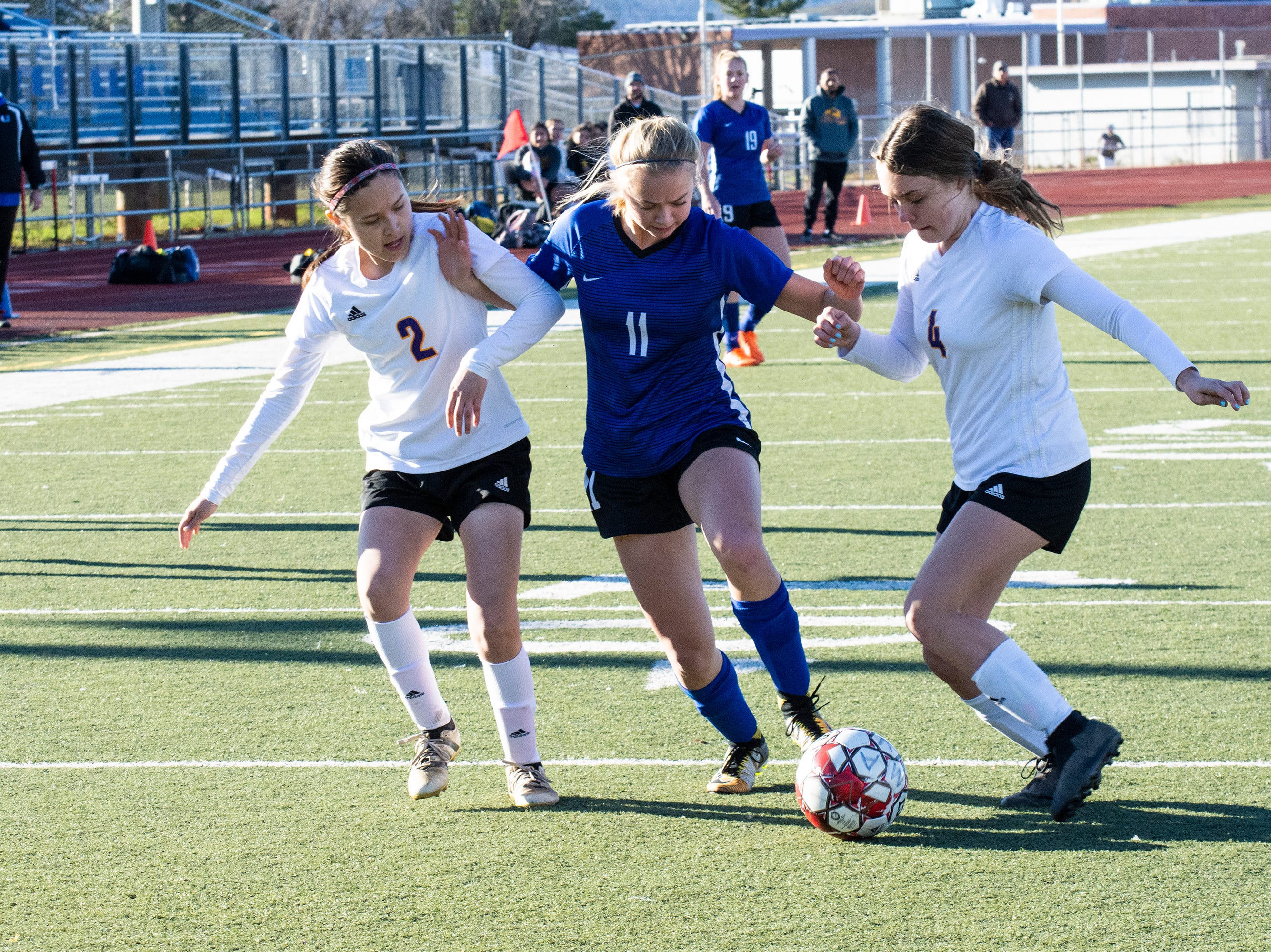U-Prep's Ryanne Ampi battles with Live Oak's Estefania Hernandez (2) and Bella Goodson (4) during the Panthers' 6-0 win in a Division II Northern Section semifinal on Thursday, Feb. 21.