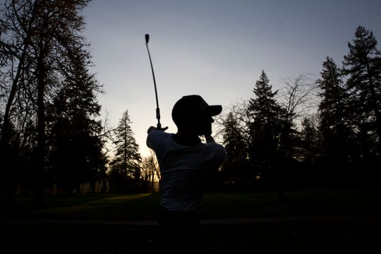 Adaptive golfer Andreas Brandenberger practices at the Salem Golf Club on Friday, Jan. 25, 2019.