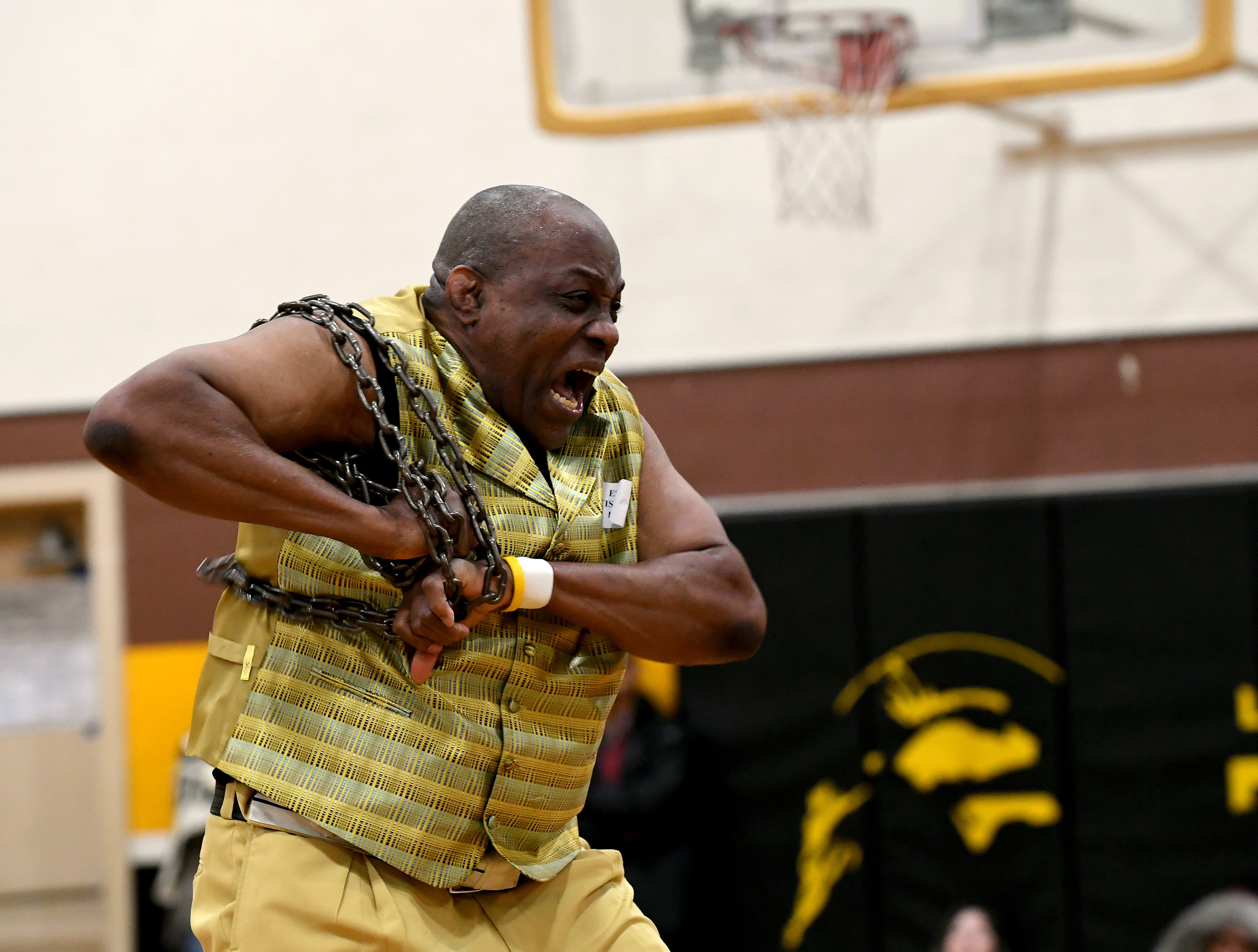 James Thompson yells during his performance with a heavy chain at El Sausal Middle School Feb. 21, 2019.