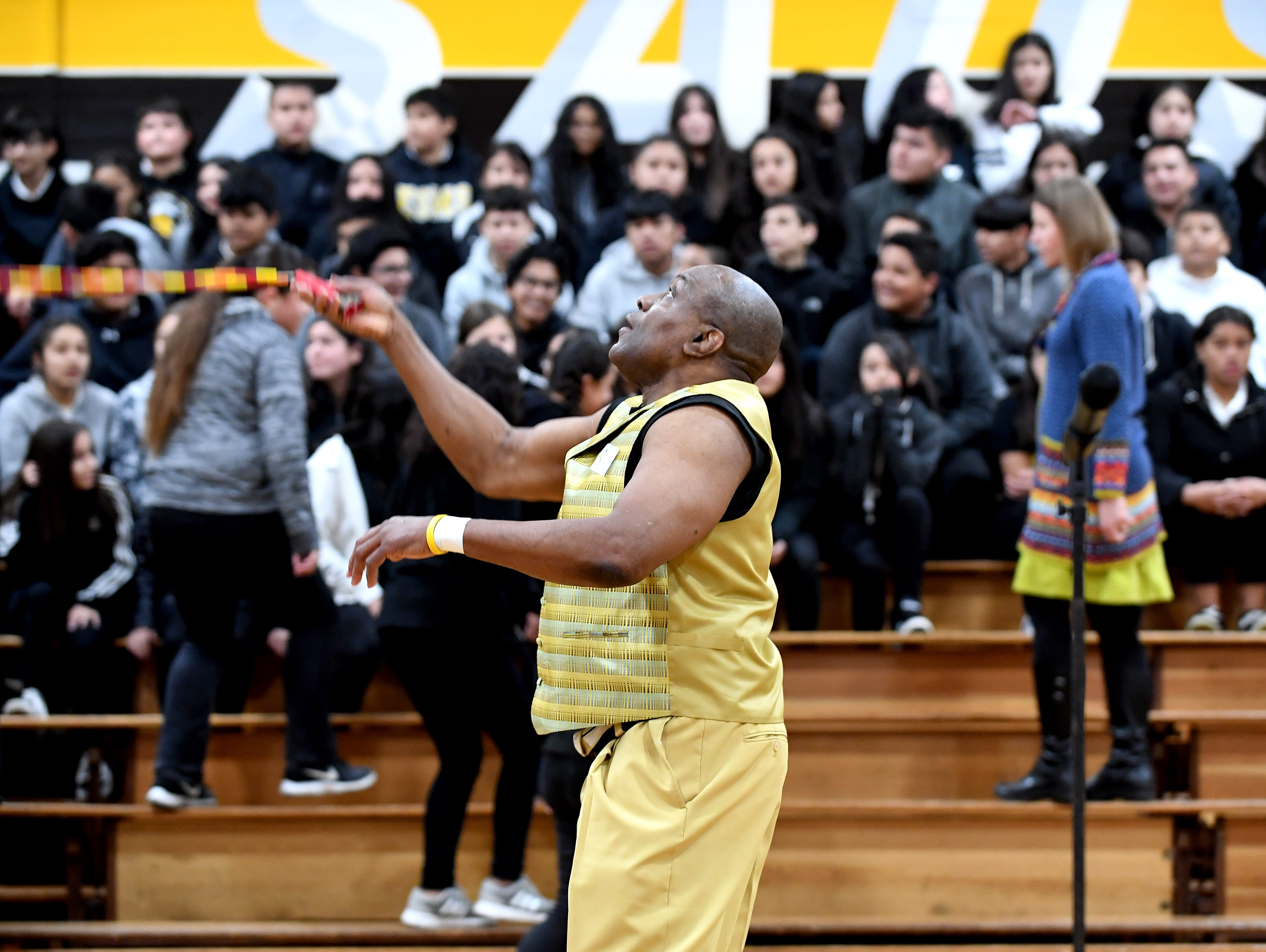 James Thompson warms up by catching a jumprope before speaking to students at his alma mater El Sausal Middle School.