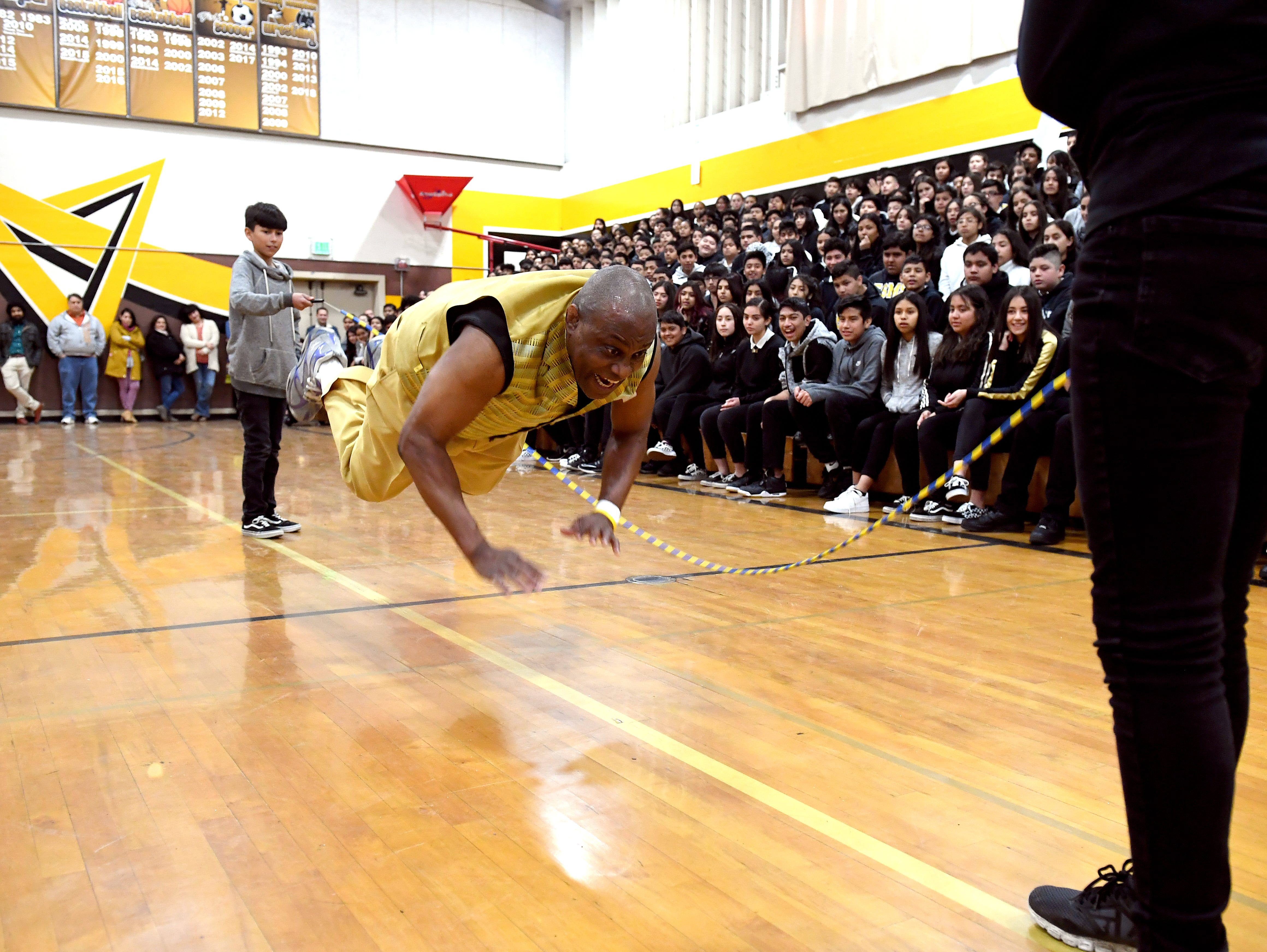 James Thompson does pushups over a jumprope during a visit to El  Sausal Middle School Feb. 21, 2019.