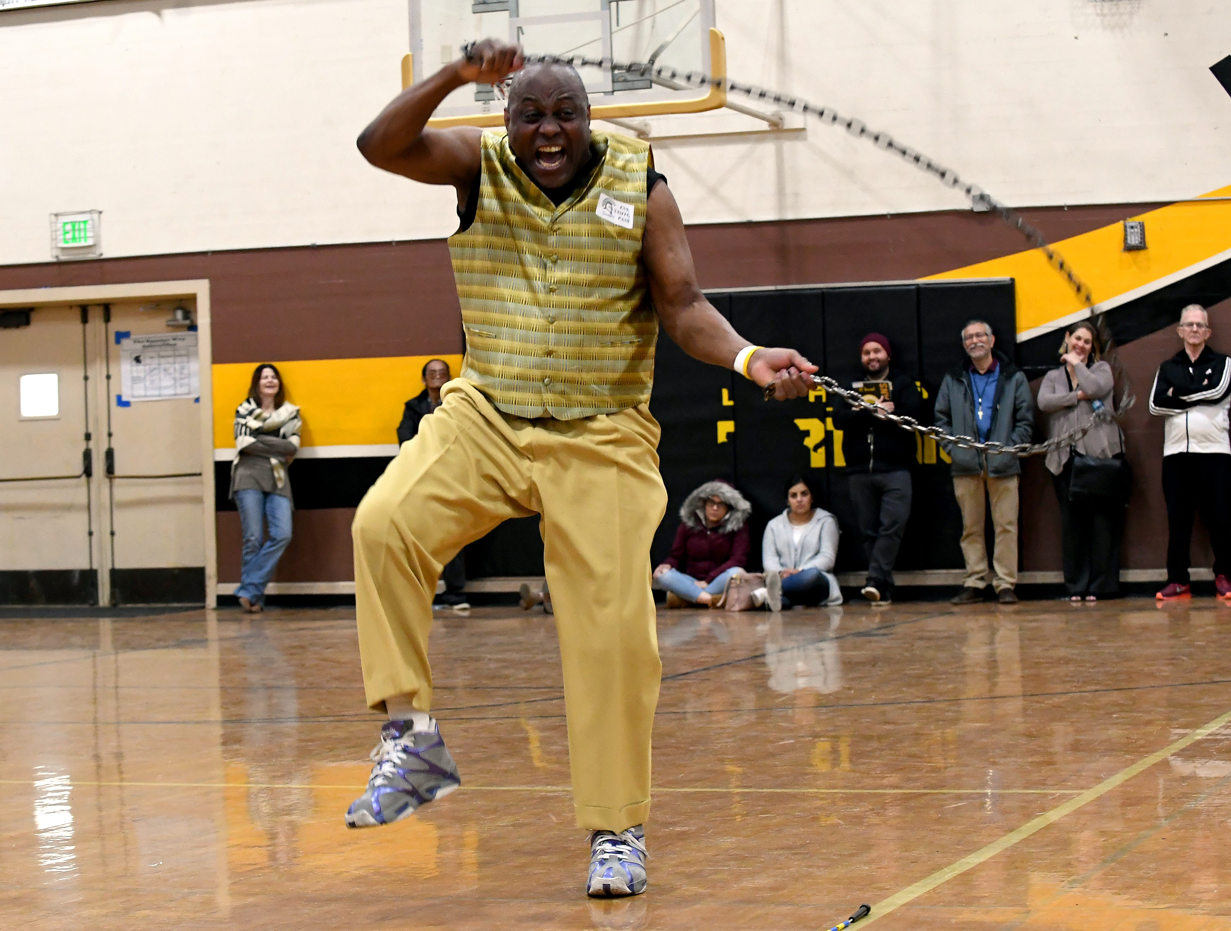 James Thompson performs with a metal chain during a visit to El Sausal Middle School on Feb. 21, 2019.