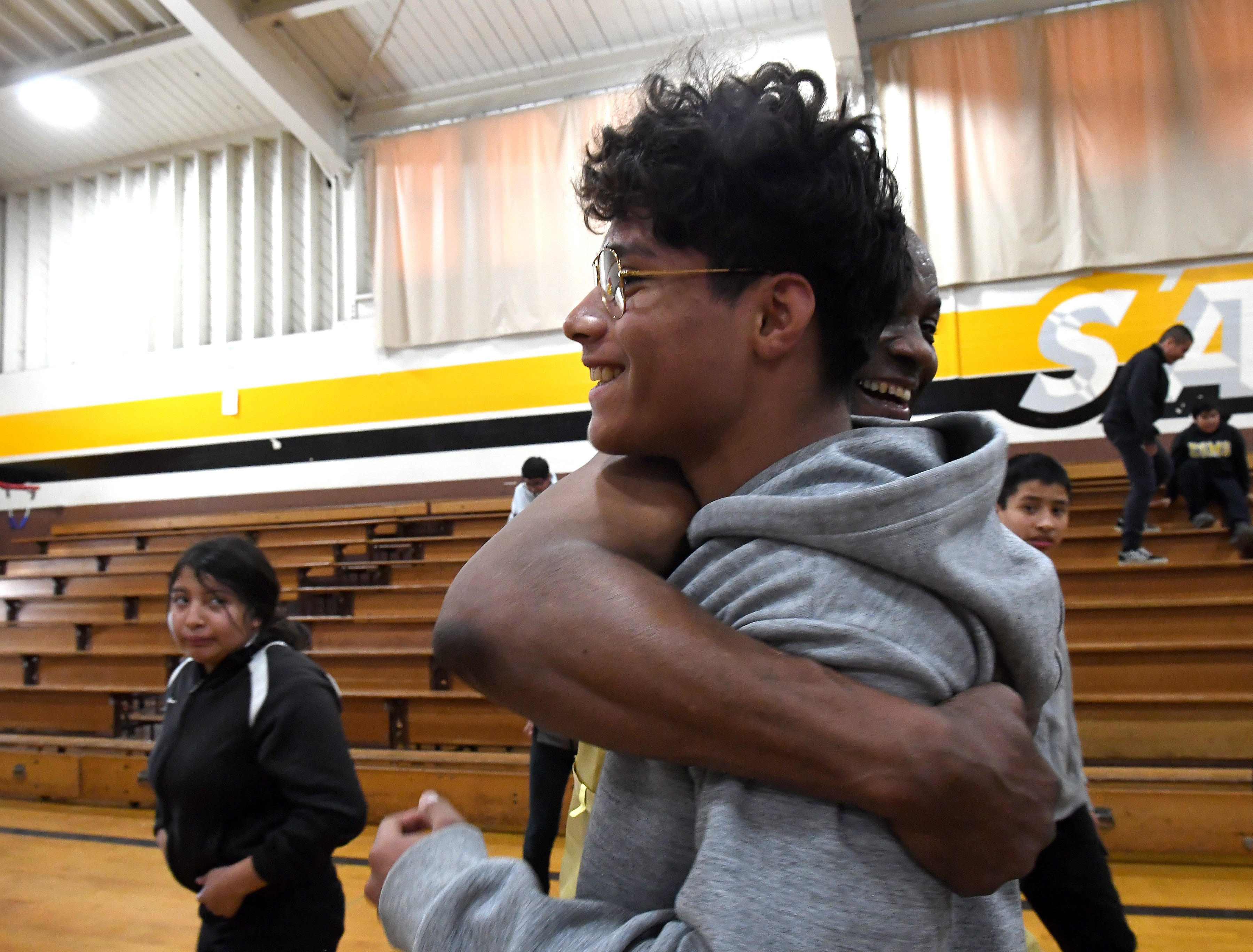 El Sausal student Abraham Maciel gets a hug from James Thompson during his visit to the middle school on FEb. 21, 2019.