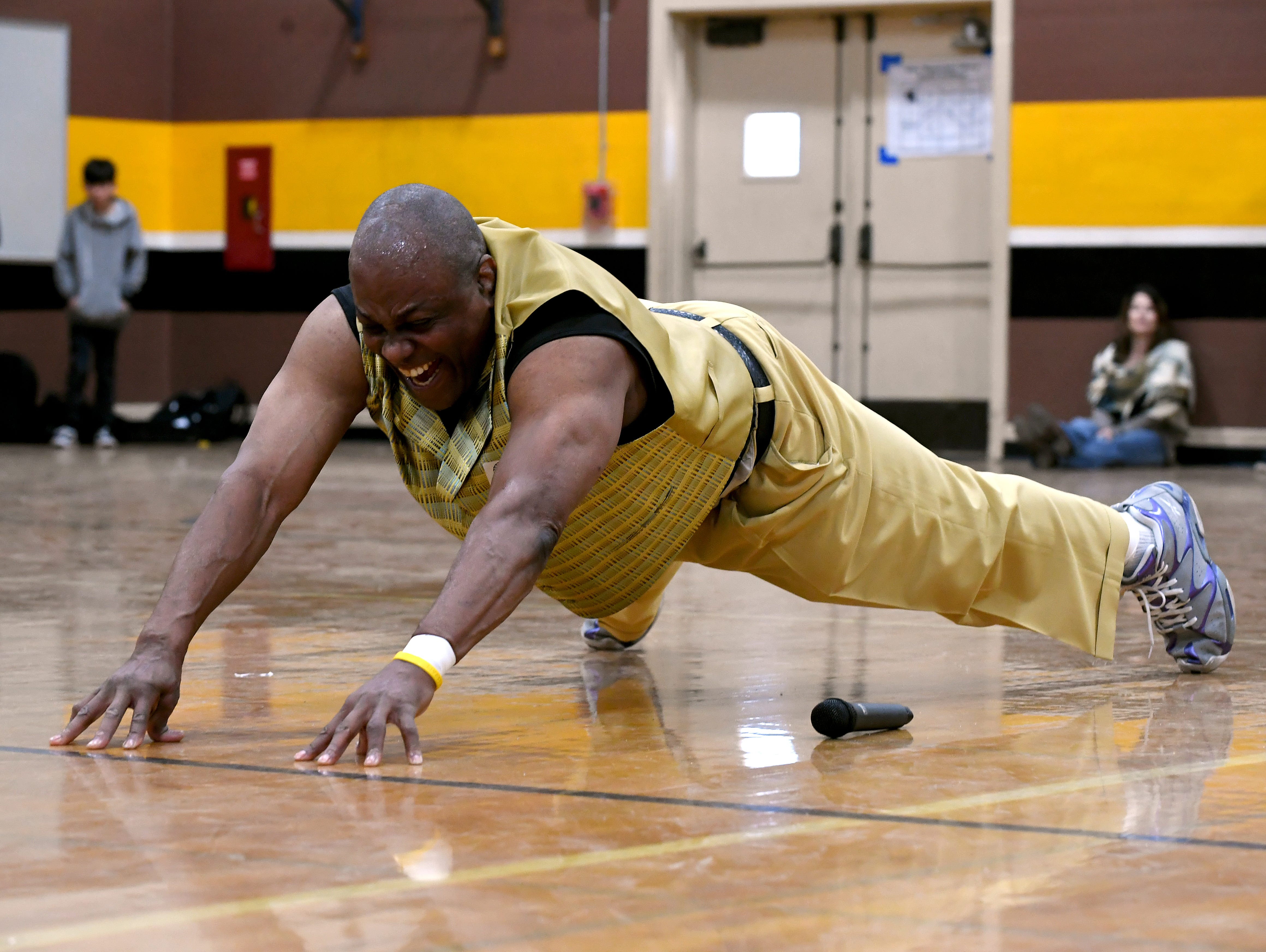 James Thompson completes a 10-finger push-up for students at El Sausal Middle School Feb. 21, 2019.