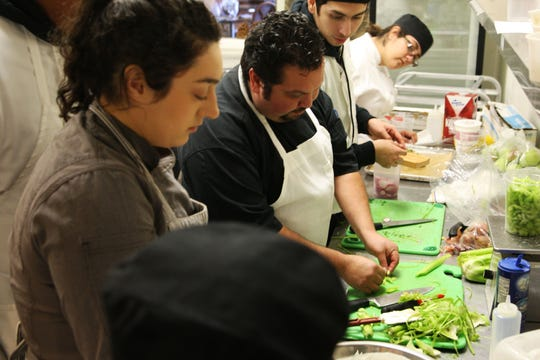 Chef Estevan Jimenez demonstrates a cooking technique to students at the Rancho Cielo Drummond Culinary Academy.