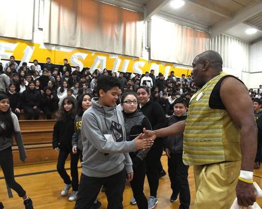 James Thompson shakes hands with students at El Sausal Middle School after a visit on Feb. 21, 2019.