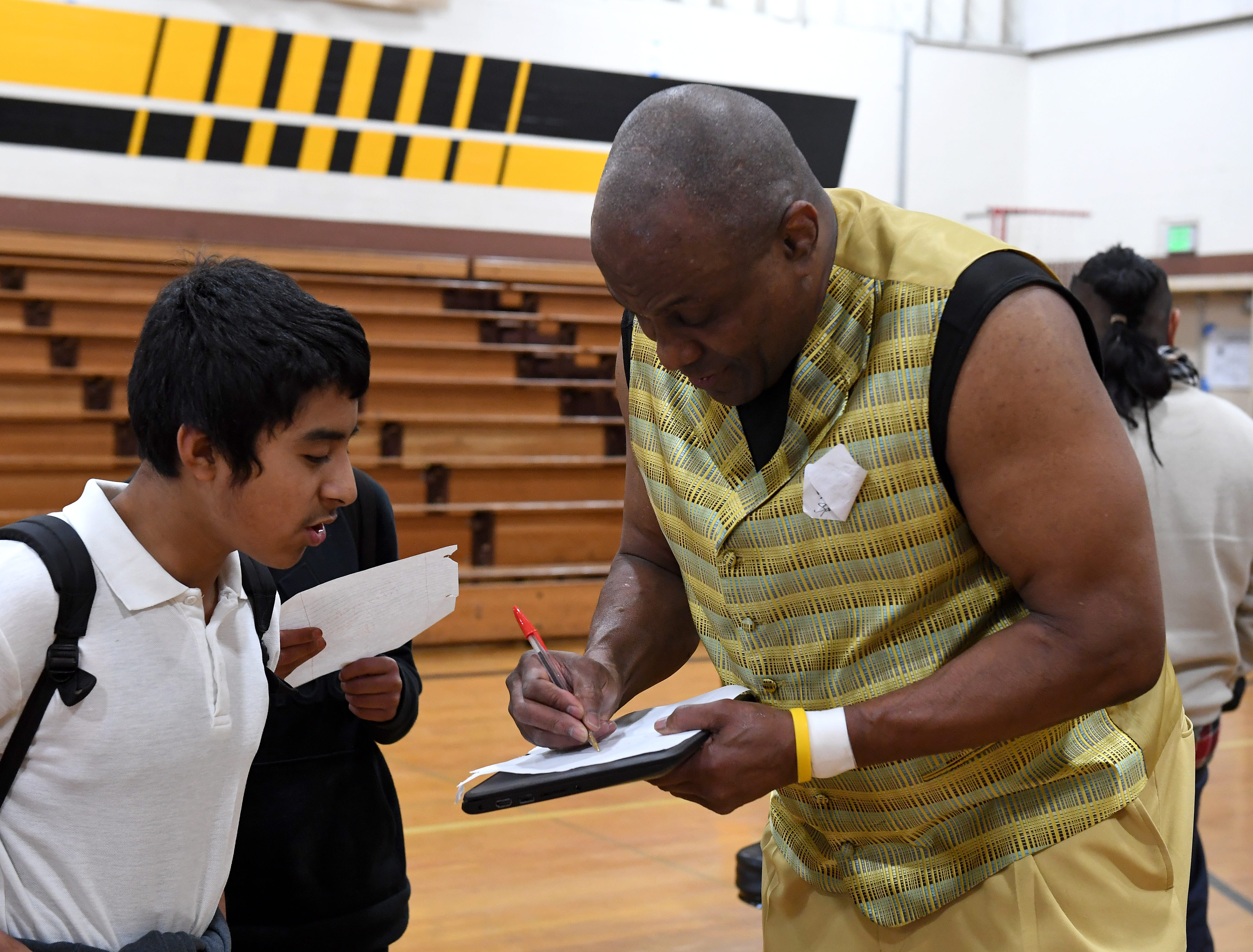 James Thompson signs his autographs for students at El Sausal Middle School Feb. 21, 2019.